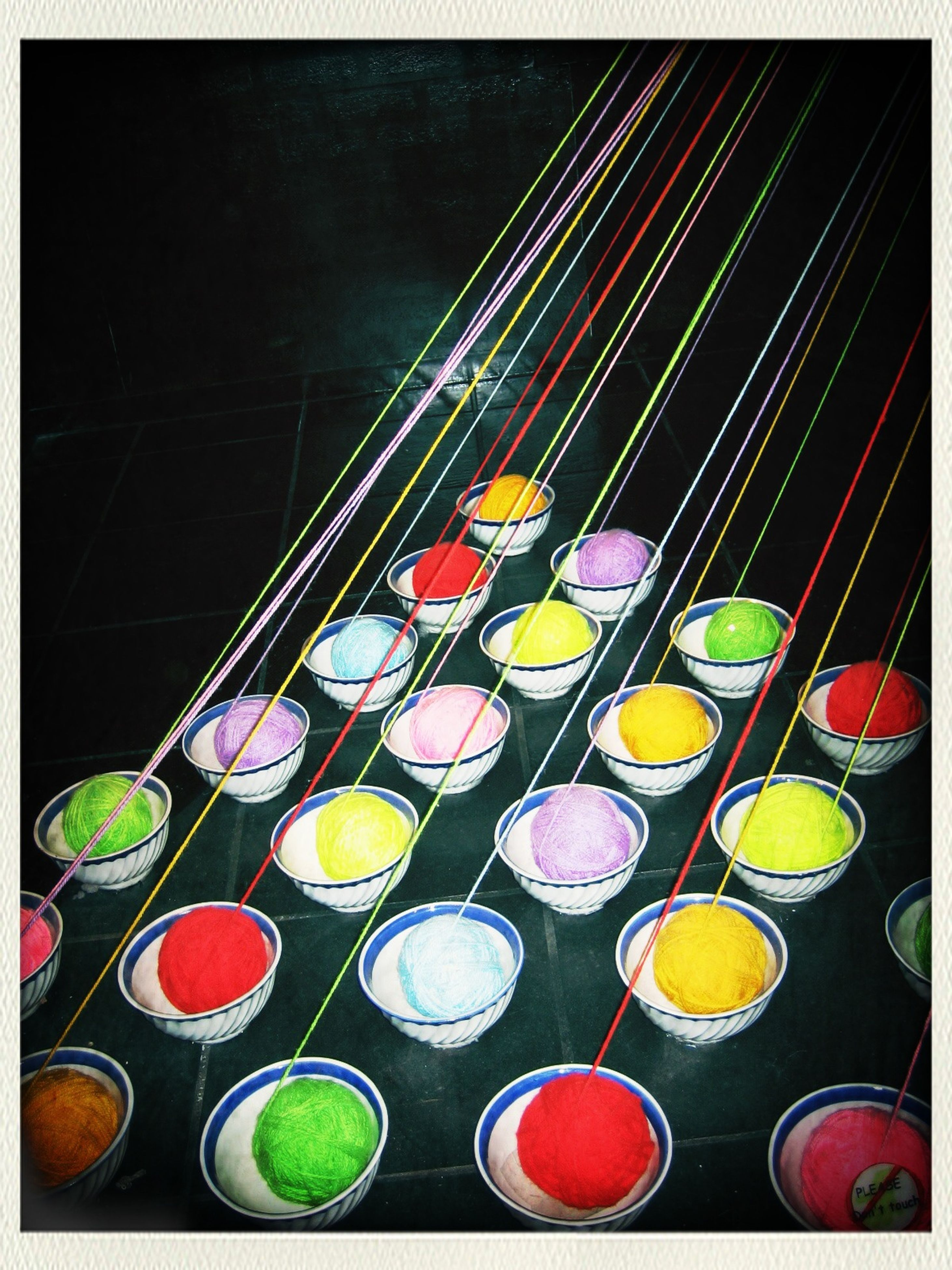 multi colored, transfer print, indoors, auto post production filter, variation, colorful, in a row, arrangement, large group of objects, illuminated, circle, abundance, choice, high angle view, no people, night, red, order, table, side by side