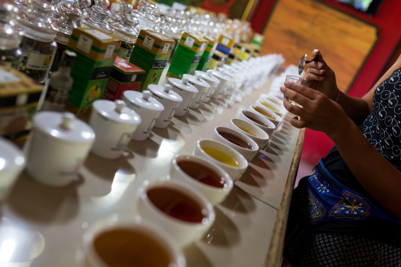 Tea Cupping in Kandy, Sri Lanka Cupping Drink Drinks Ella Human Hand Indoors  Industry Kandy Organic Plantation Quality Sri Lanka Taste Tasting Tasting Room Tasting Tea Tea Tea - Hot Drink Tea Cup Tea Is Healthy Tea Plantation  Tea Time