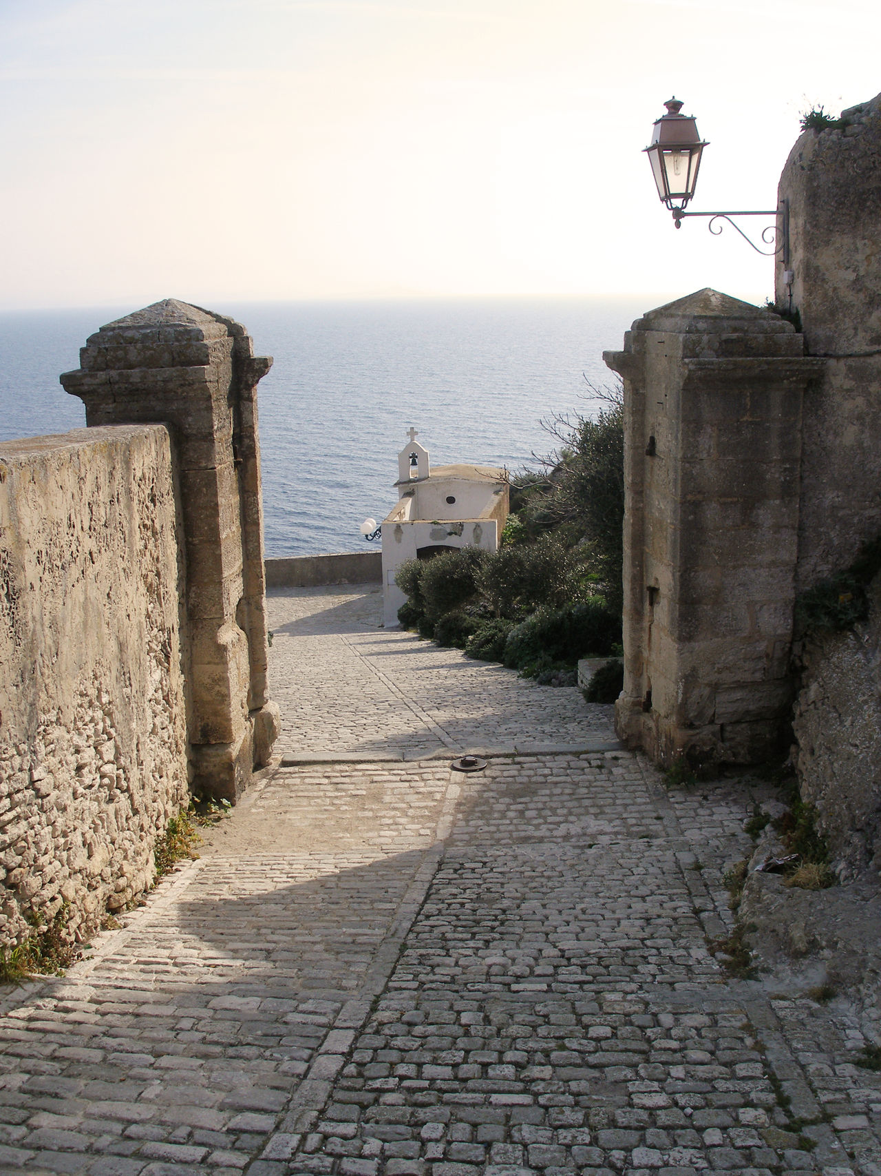Tiny little church in Bonifacio, Corsica Architecture Bonifacio Building Exterior Built Structure Chapel Church City Walls Corsica Day Footpath France Gate Horizon Over Water Mediterranean  Nature No People Outdoors Path Perspective Sea Sky Sunny Day Sunshine Walkway Water