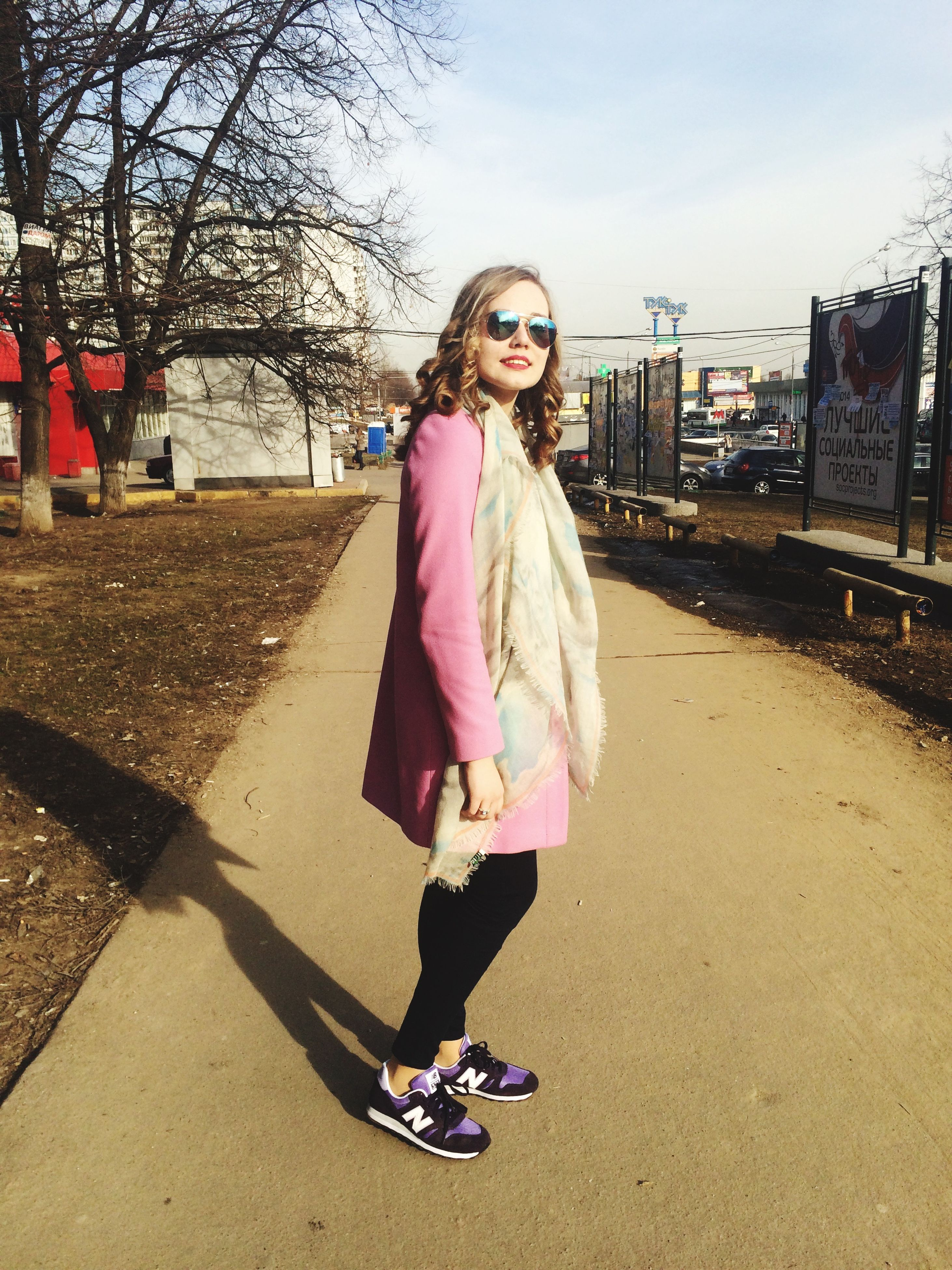 person, young adult, lifestyles, casual clothing, full length, looking at camera, portrait, young women, leisure activity, front view, smiling, happiness, street, road, sunglasses, standing, transportation