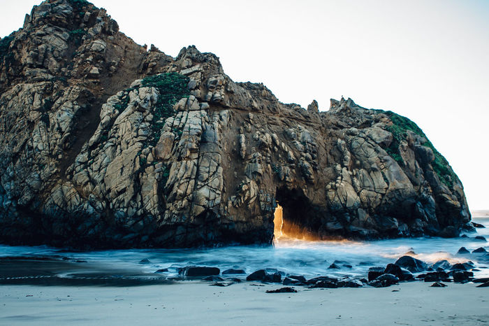 This arch shows magnificent sunlight during winter time . It is located at Pfeiffer Beach in Big Sur California. Beauty Beauty In Nature Big Sur California Coast Key Hole Arch Landscape Long Exposure Nature No People Outdoors Pfeiffer Beach Rock - Object Scenics Sea Sunset Tourism Travel Destinations Water Finding New Frontiers Miles Away The Secret Spaces