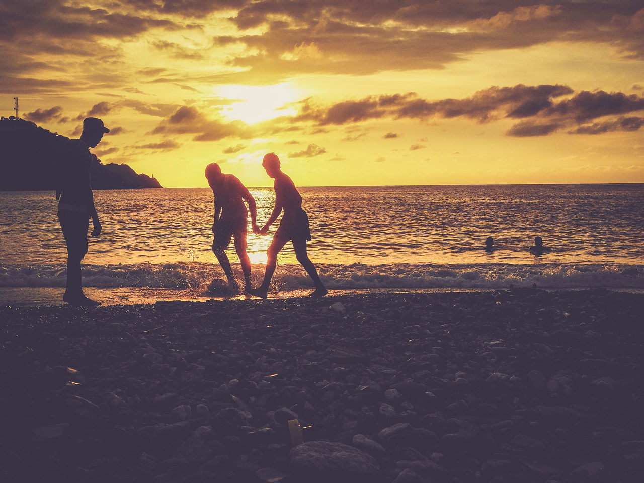 Young boys playing football on the beach during sunset Beach Boys Clouds Colombia Football Friendship Horizon Over Water Leisure Activity Men Playing Real People Sand Sea Shore Silhouette Southamerica Sunset Togetherness Vacations Water
