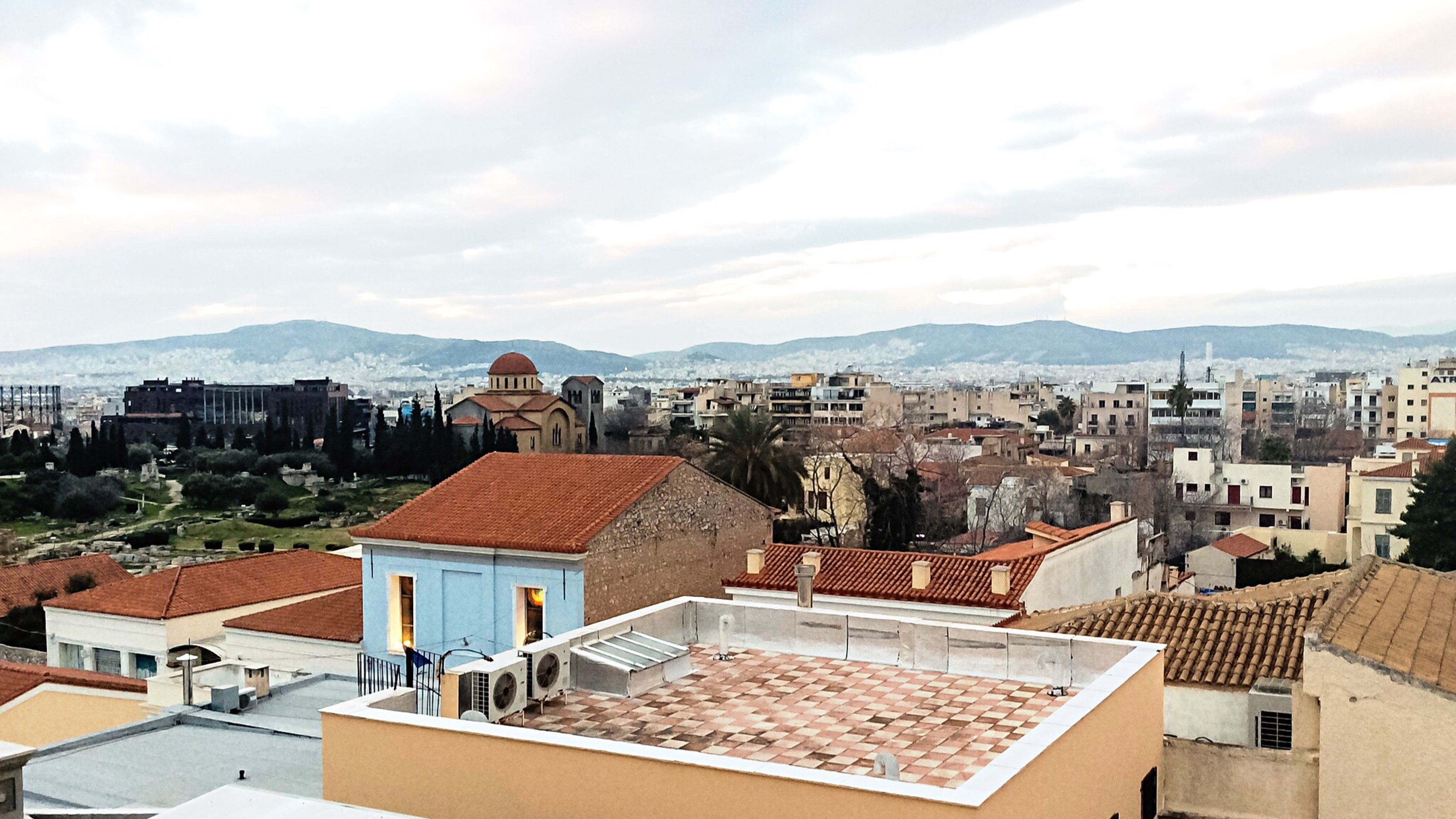 Another one from the Roof of my office Building . Rooftops of the Neighborhood , part of Kerameikos Cemetery , a Church totally out of scale, the western suburbs of the City , the Athenian Sky on a winter's eve... My habitat during weekdays... My Life In Ruins Urban Palimpsest History Through The Lens  Historical Monuments Historical Place Cityscapes Cityscape Urban Landscape View From Above No People Architecture Discover Your City From My Point Of View Athens Greece