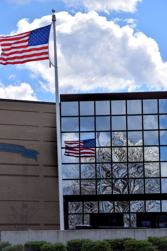 American Flag Building Exterior Flag Flag Pole Mirrored Patriotism Reflections School School Building US Flag USA Window