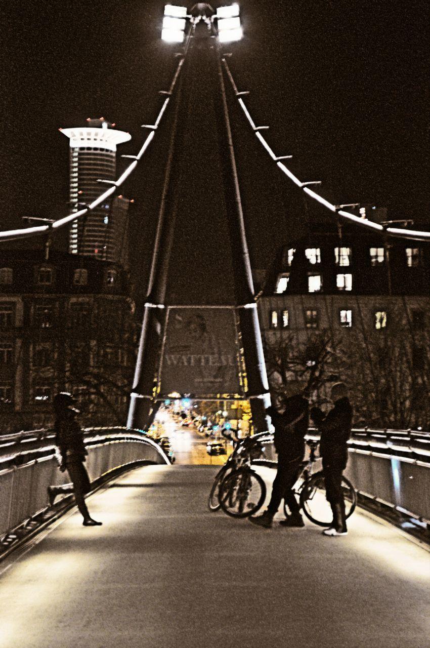 transportation, night, full length, illuminated, men, real people, helmet, city, architecture, outdoors, people, only men, adults only, adult