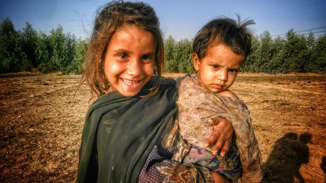 Smilling Children Photography Joyfull Lifestyles Innocent Face Innocent Eyes People Of EyeEm Children Friendship Love Tradiotional Cloths Cultures Togetherness Togetherness Portrait Looking At Camera Bonding Leisure Activity Love Tree Lifestyles Field Sand Vacations Friendship