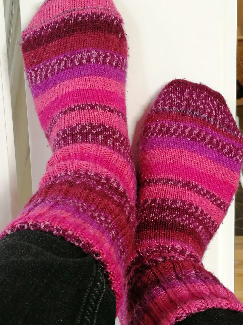 one person, human leg, pink color, sock, low section, indoors, human body part, shoe, real people, close-up, fashion, wearing, wool, warm clothing, day, people