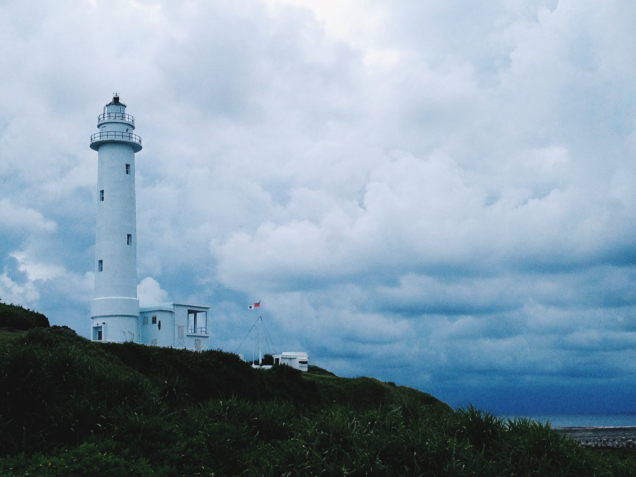 Architecture Beauty In Nature Built Structure Cloud Cloud - Sky Cloudy Colour Of Life Day Direction Grass Greenisland Idyllic Landscape Lighthouse Nature No People Outdoors Overcast Protection Safety Scenics Security Sky Taiwan Weather