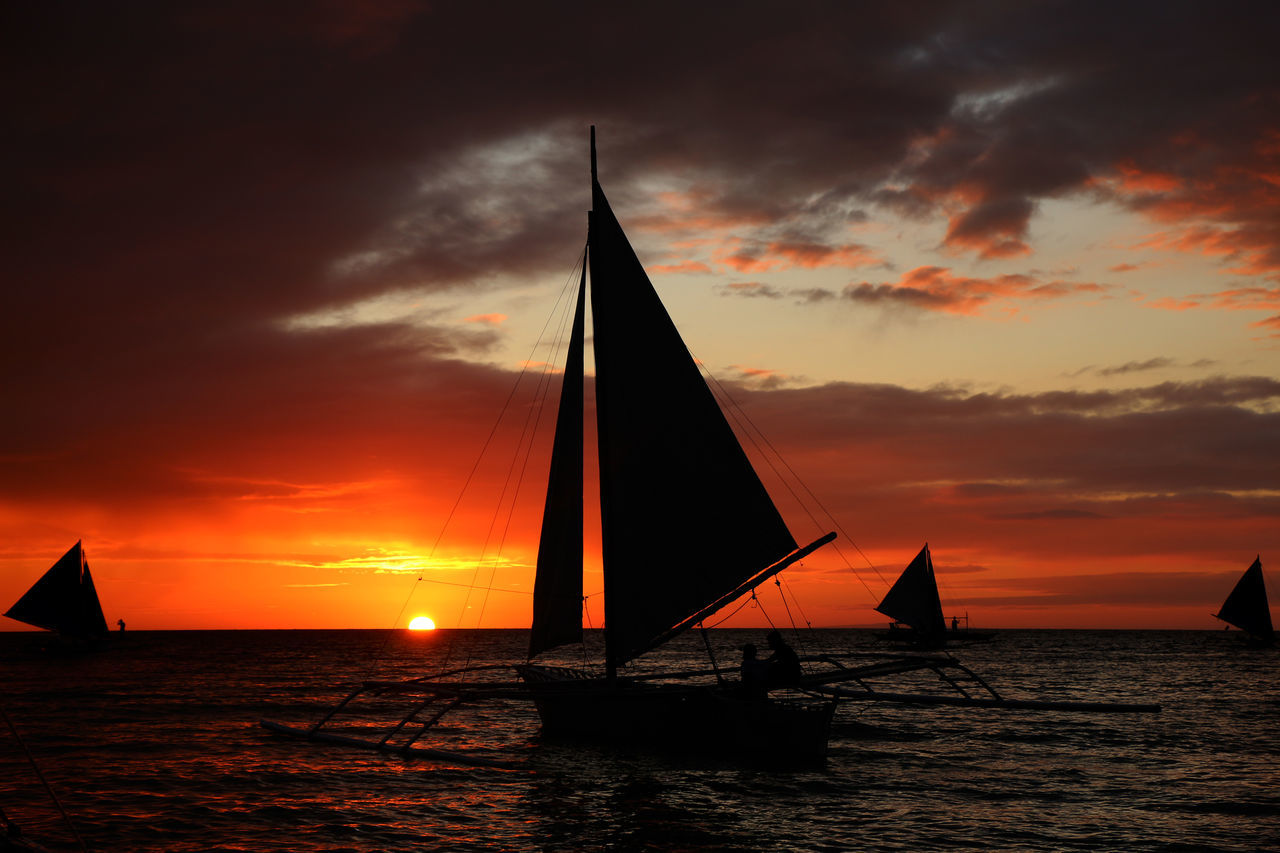 Cloud - Sky Competition Competitive Sport Nature Nautical Vessel Night Outdoors People Regatta Sailboat Sailing Sea Silhouette Sky Sport Sports Race Sports Team Sunset Vacations Water Yacht Yachting