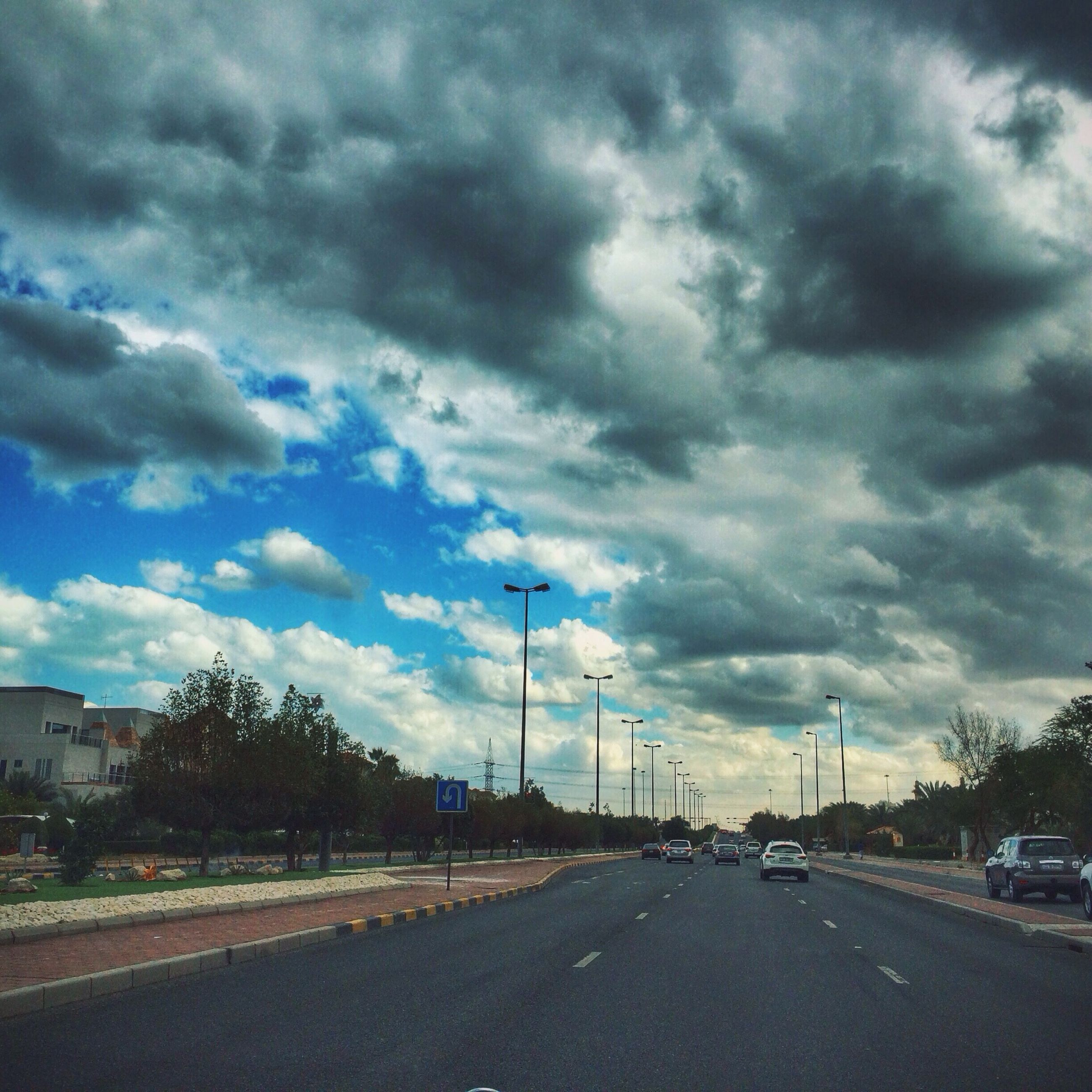 transportation, road, sky, cloud - sky, the way forward, car, road marking, cloudy, street, land vehicle, diminishing perspective, cloud, street light, vanishing point, mode of transport, overcast, asphalt, outdoors, empty, highway