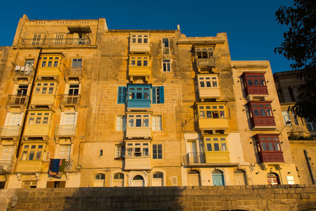 Valletta balconiesand old buildings, in late afternoon lights. Malta Afternoon Architecture City Malta Mediterranean  Valletta,Malta Architecture Balconies Balcony Building Building Exterior Built Structure Day Destination Landmark Late Afternoon Light Medieval No People Romantic Building Street Sunset Travel Destinations Urban Warm Colours Yellow