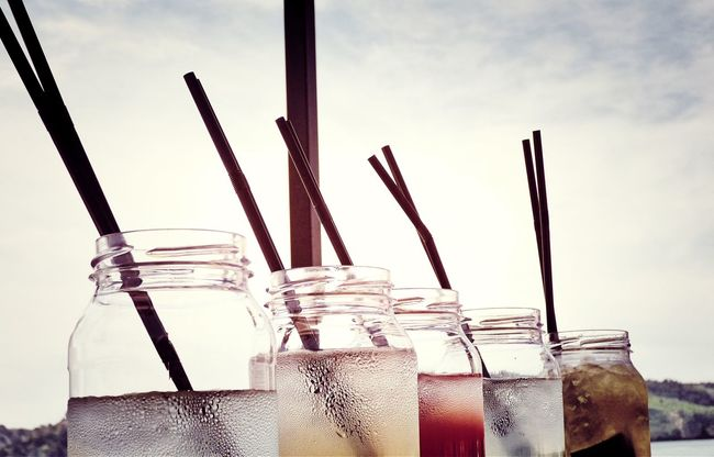 The cocktails hummm Close-up Cloud Cocktails Cocktails & Glasses Cocktails🍹🍸 Day Glass - Material Low Angle View No People Outdoors Repetition Side By Side Sky Straws The Cocktails