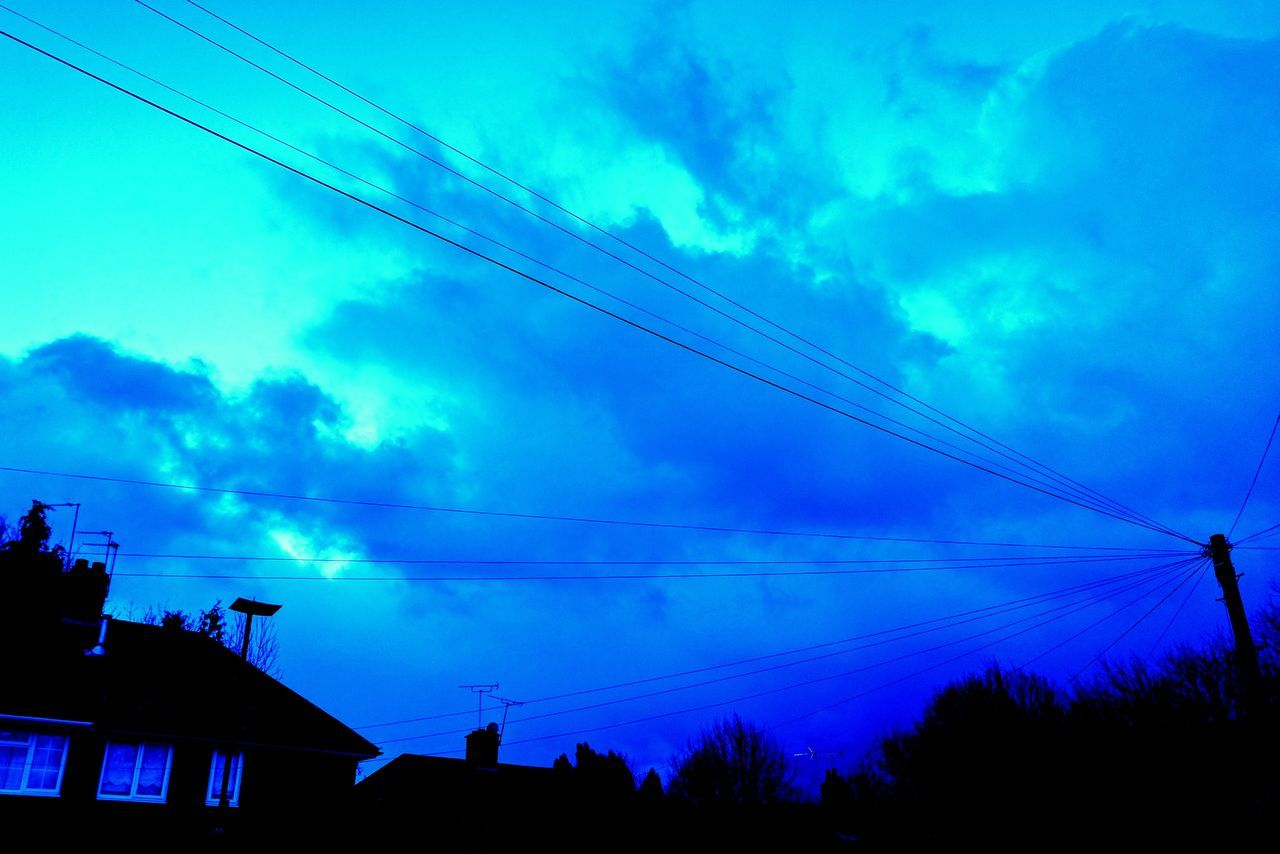 Architecture Building Exterior Built Structure Cable Cloud - Sky Connection Day Electricity  Electricity Pylon Fuel And Power Generation Low Angle View Nature No People Outdoors Power Line  Power Supply Silhouette Sky Technology Telephone Line Telephone Pole Tree Vapor Trail