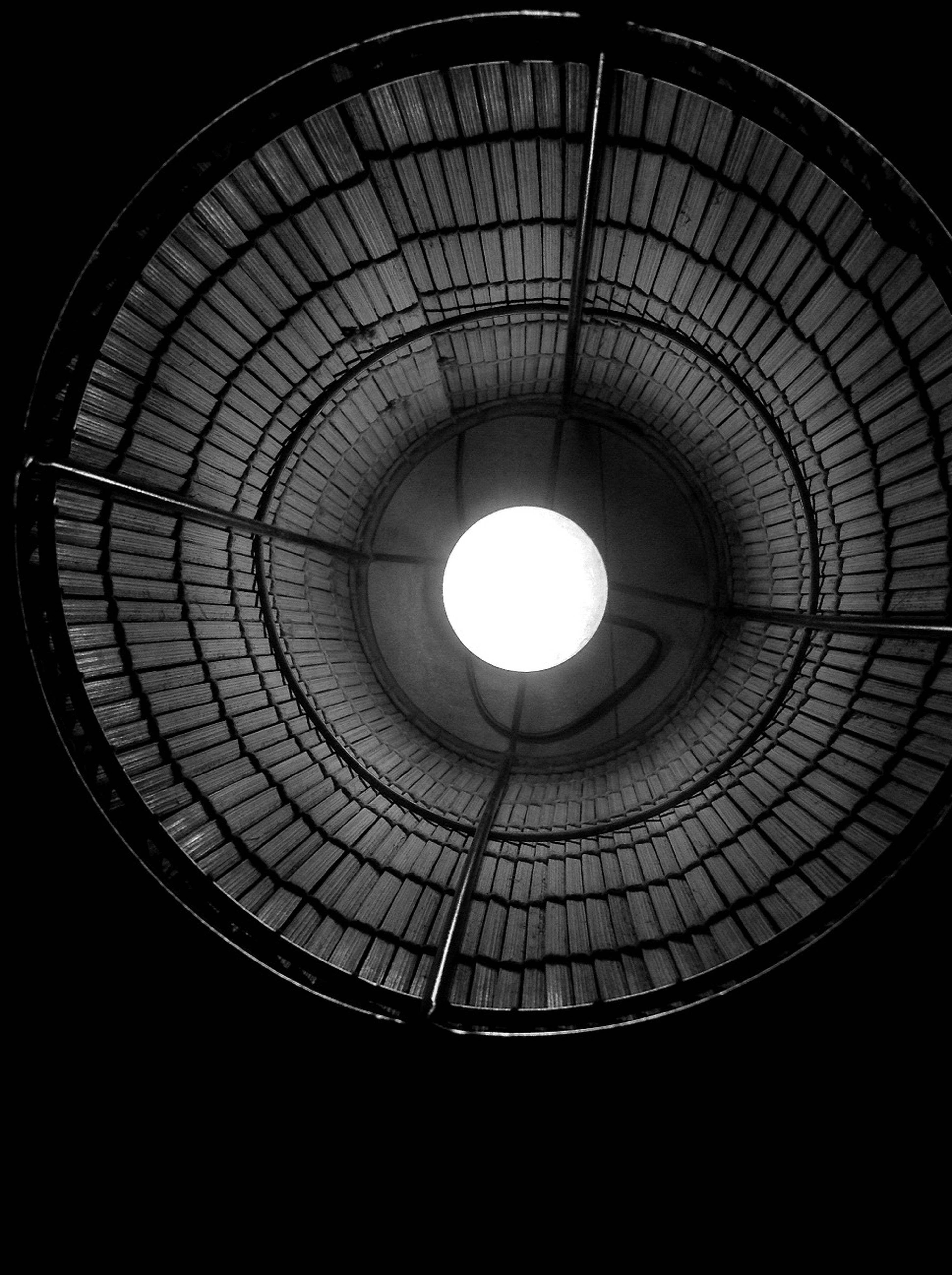 low angle view, illuminated, indoors, ceiling, lighting equipment, circle, built structure, architecture, directly below, geometric shape, electric light, electricity, electric lamp, pattern, glowing, light - natural phenomenon, no people, modern, shape, lamp