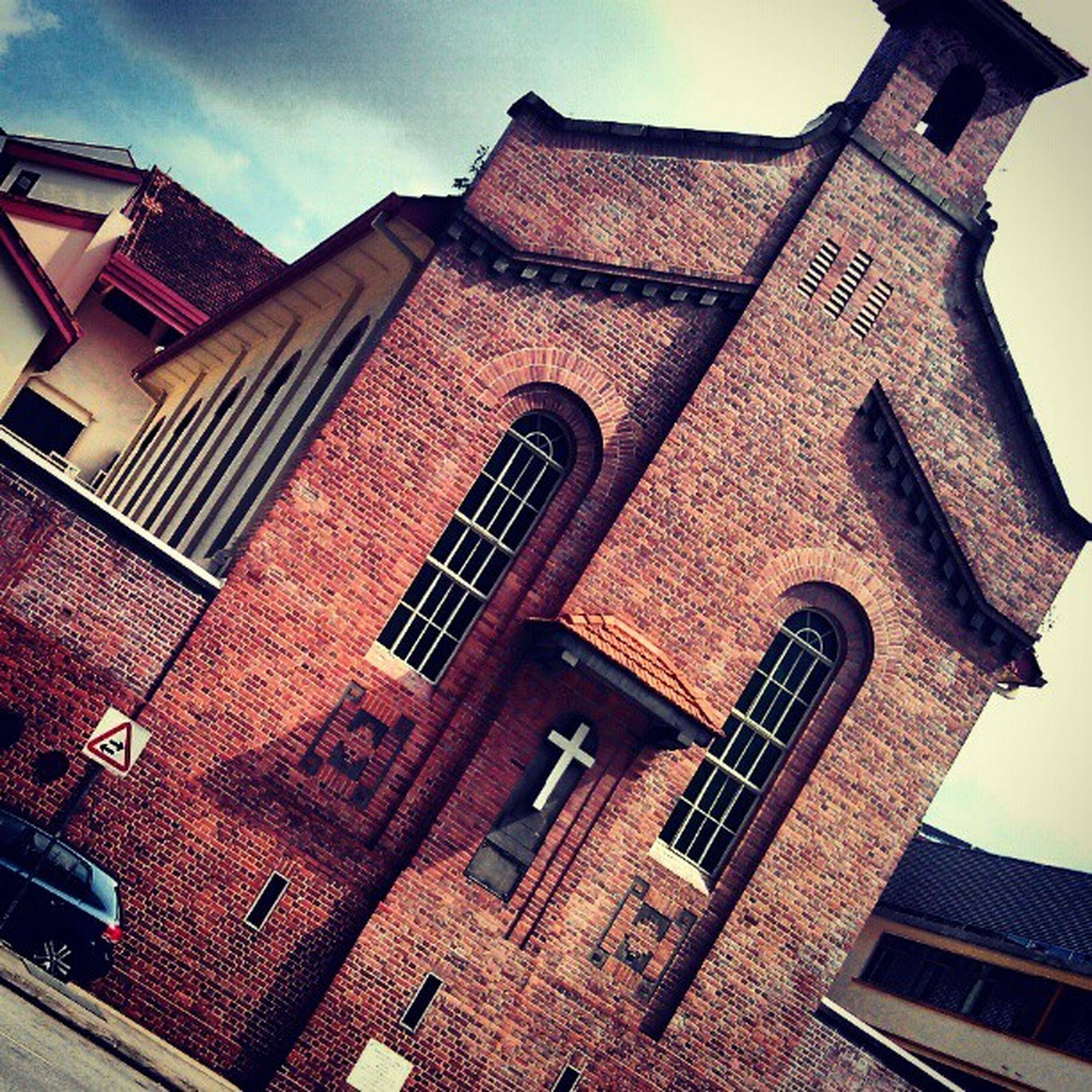 architecture, building exterior, built structure, low angle view, window, sky, arch, history, church, tower, religion, day, outdoors, building, old, no people, sunlight, facade, place of worship