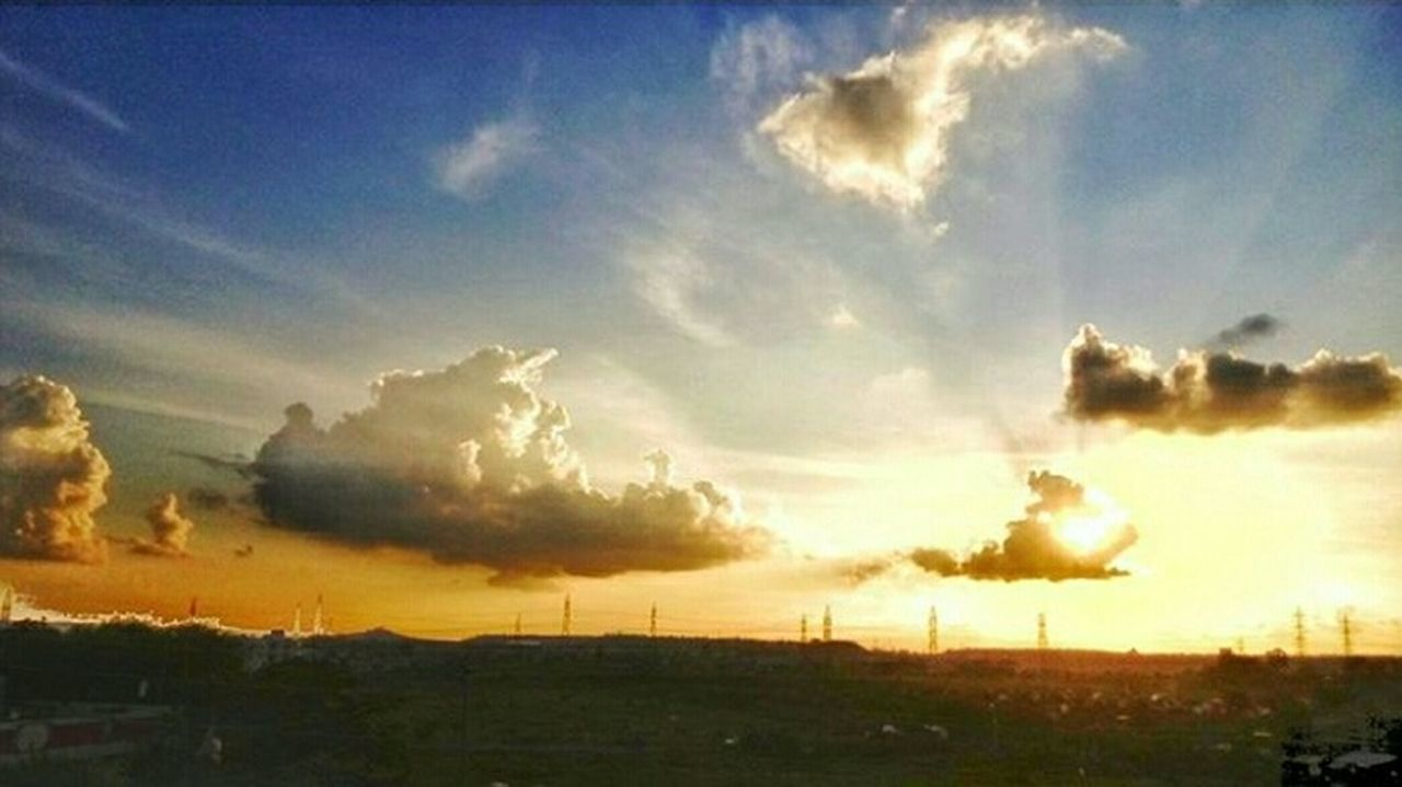 sky, cloud - sky, nature, no people, outdoors, sunset, scenics, field, tranquility, landscape, day, beauty in nature, rural scene, tree