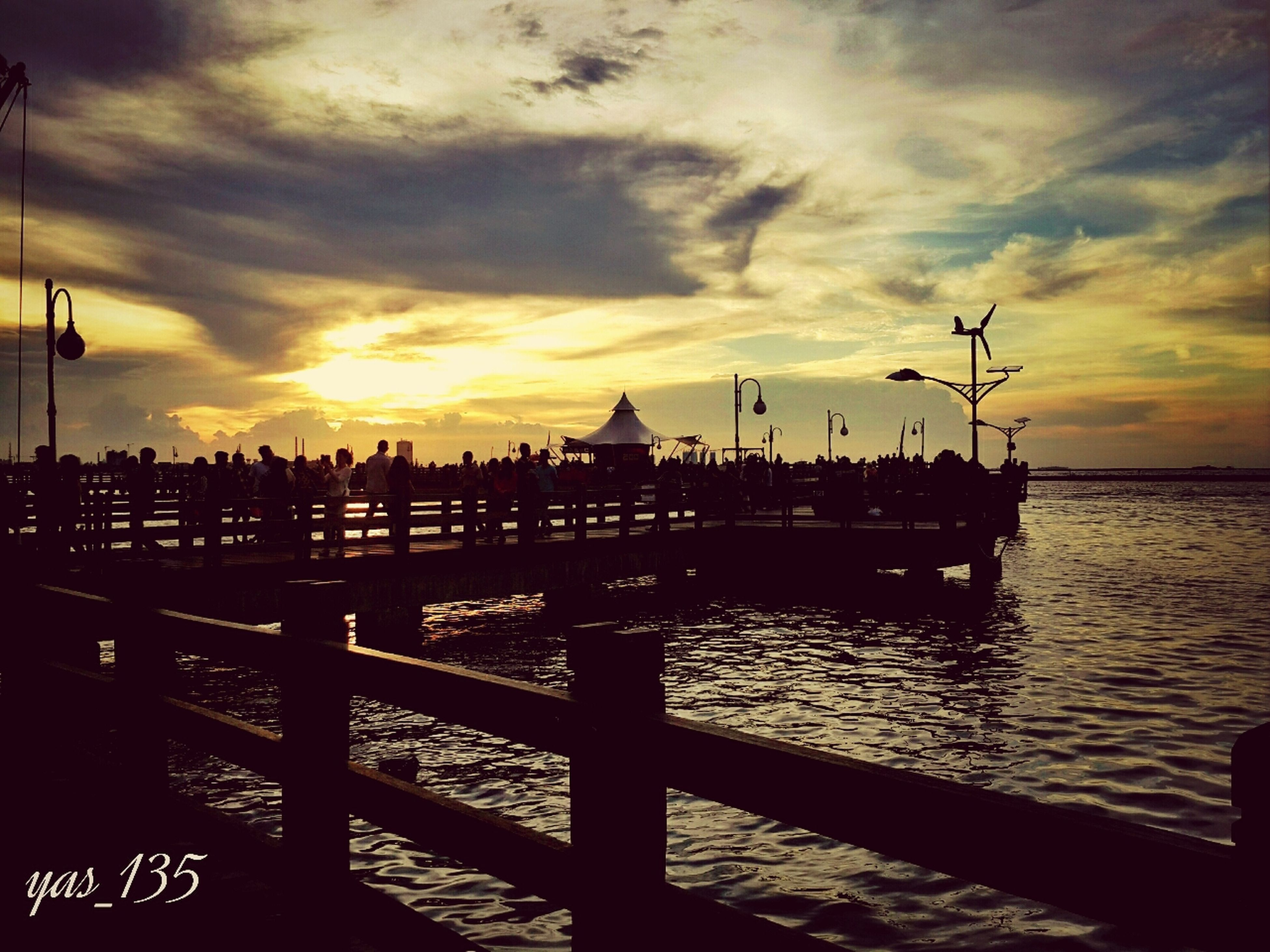 sunset, water, sky, sea, cloud - sky, transportation, nautical vessel, mode of transport, silhouette, cloudy, nature, scenics, beauty in nature, orange color, boat, cloud, pier, tranquility, harbor, tranquil scene