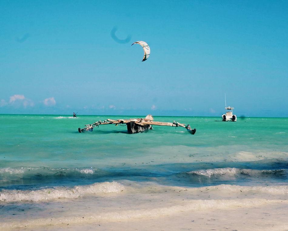Flying Sea Beach Sky Outdoors Vacations Nature Travel Destinations Motion Adventure Kiteboarding Beauty In Nature Cloud - Sky Horizon Over Water Water Clear Sky Zanzibar_Tanzania Zanzibar Hotel Paje Kitesurf Zanzibarisland Zanzibar Sand