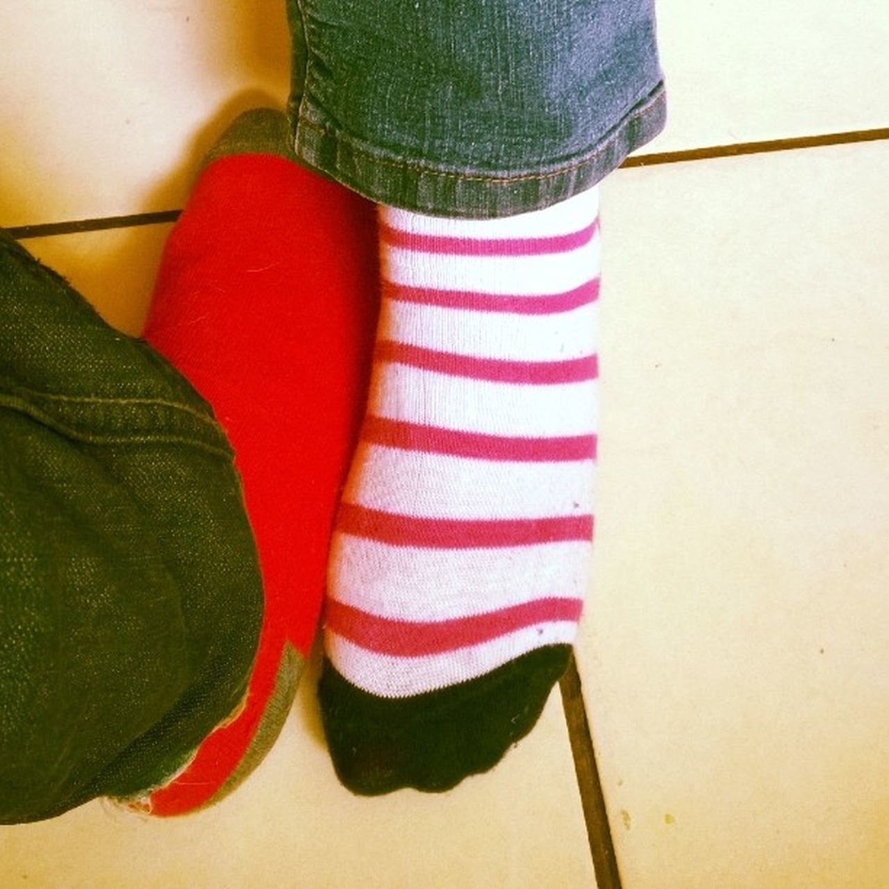 human leg, striped, low section, indoors, close-up, human body part, real people, sock, two people, standing, togetherness, red, day, young women, young adult, people
