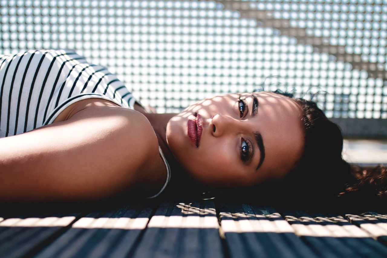 Portrait Beautiful Woman Looking At Camera Young Adult Lying Down One Person Beauty Young Women Fashion Indoors  Beautiful People Relaxation One Woman Only One Young Woman Only Fashion Model Day Only Women Close-up Adult Adults Only London The Portraitist - 2017 EyeEm Awards