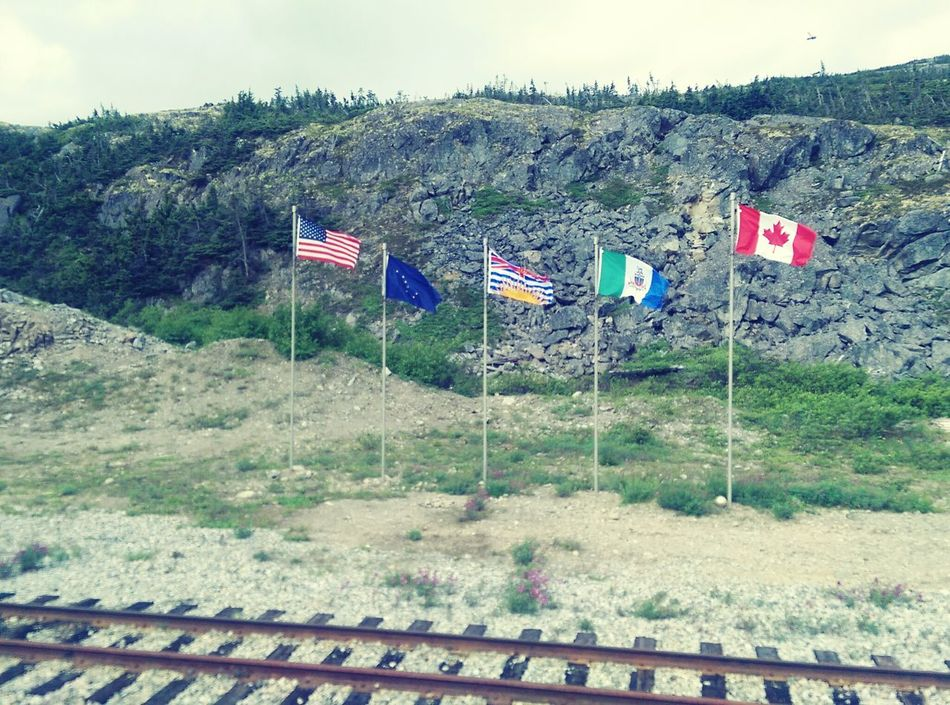 Alaska White Pass Trainphotography Canada Landscape Beauty In Nature Whitepass & Yukon Railroad Flags In The Wind  Flags Flag Day Nature Outdoors Landscape_photography Train Tracks MY FIRST SALE ON EyeEM!!! Finding New Frontiers