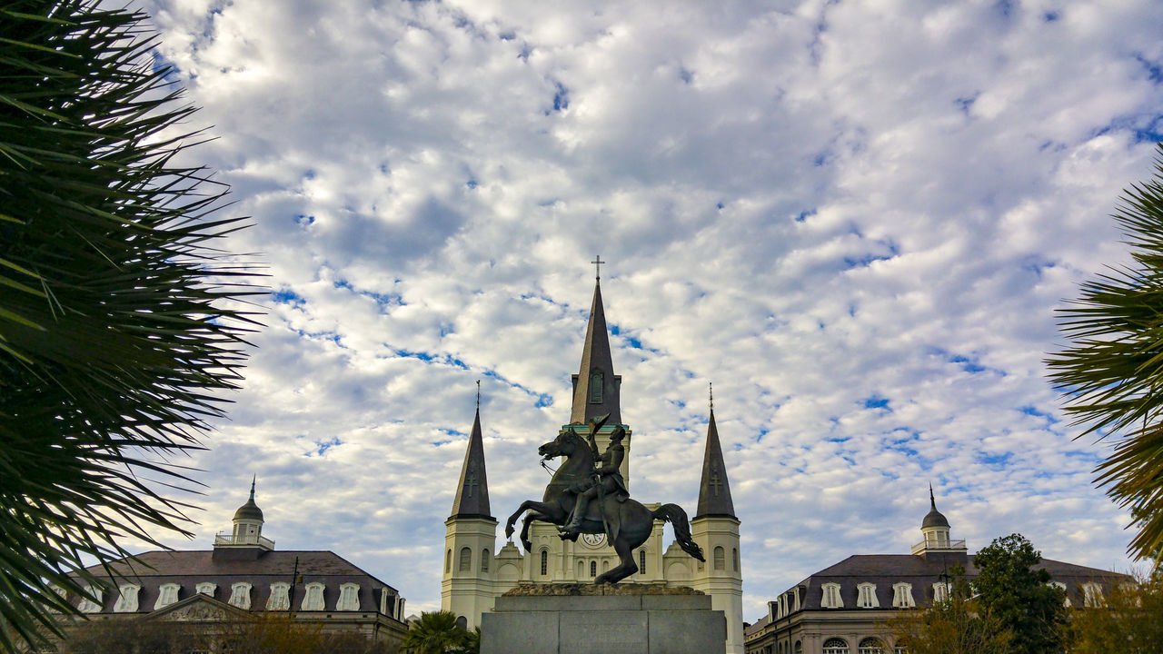 Jackson Square, New Orleans, United States Architecture Building Exterior Built Structure Church Cloud Cloud - Sky Cloudy Day Growth High Section Jackson Square Louisiana Low Angle View Nature New Orleans No People Outdoors Place Of Worship Religion Sky Spirituality Travel Destinations Tree United States Weather