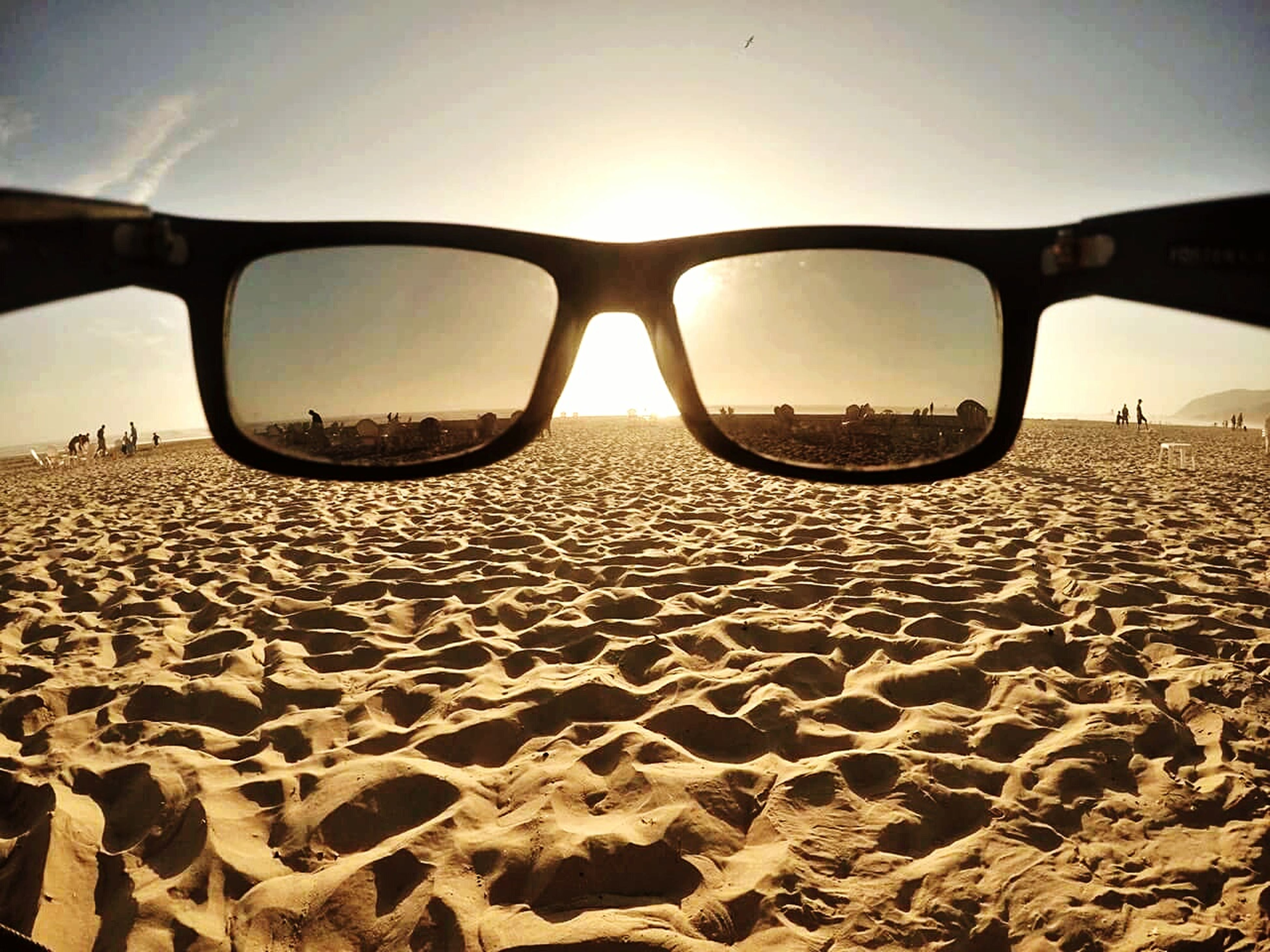 sunglasses, sand, sunset, nature, eyeglasses, beach, sky, eyewear, no people, outdoors, water, beauty in nature, day, close-up