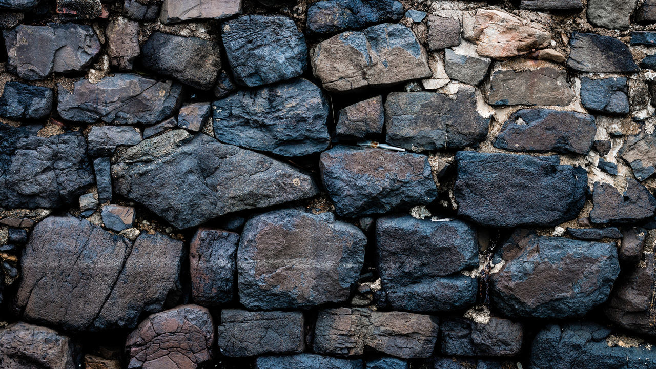 Wall at Tobermory Beach, Mull Abstract Abstract Photography Backgrounds Beachside Black Blue Close-up Cracked Day Full Frame Granite Large Group Of Objects Natural Nature No People Outdoors Paintbrush Rocks Sea Sea Wall Slate Stack Stone Stone Material Wall