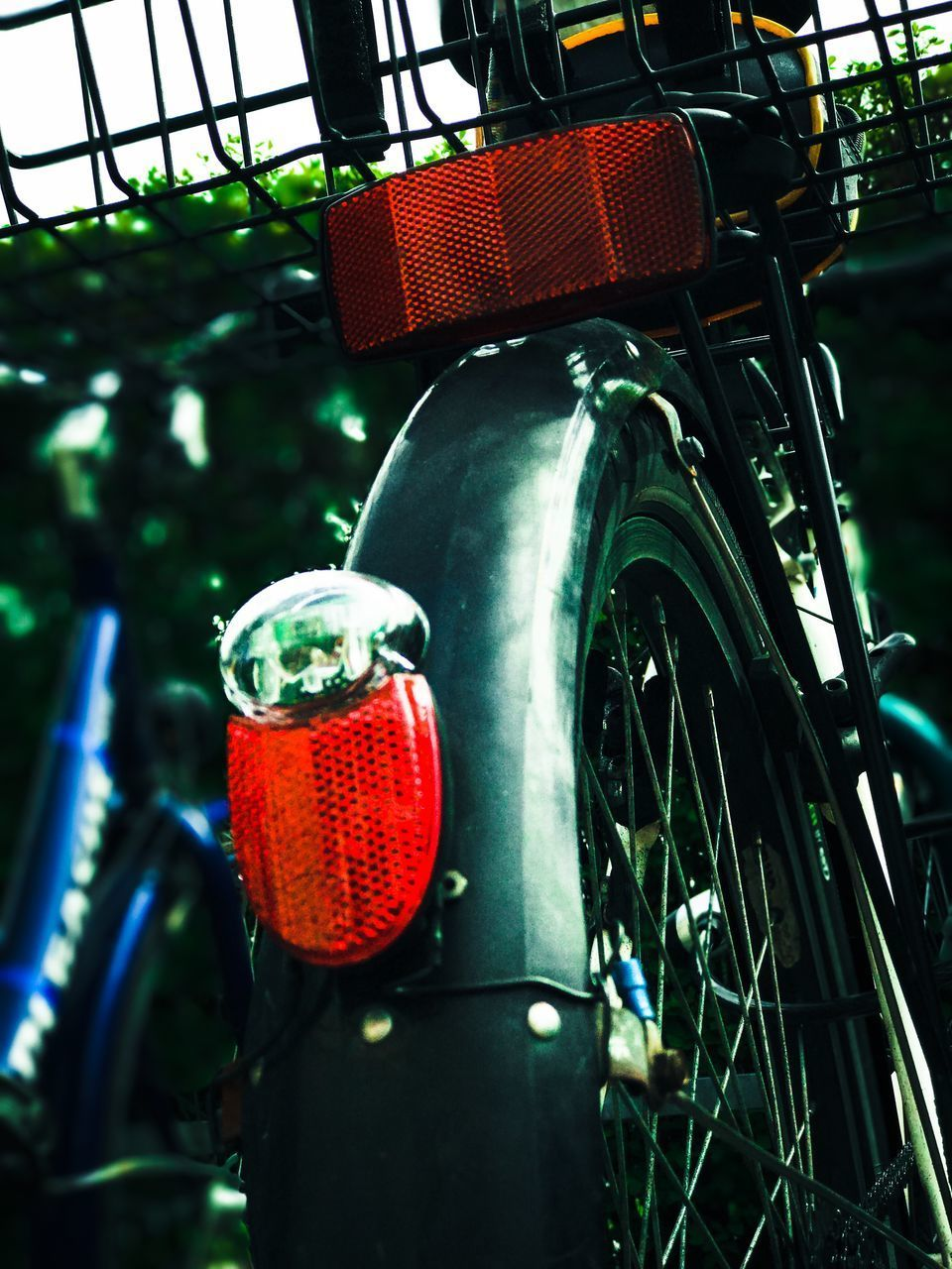 transportation, mode of transport, outdoors, no people, land vehicle, day, stationary, red, bicycle, green color, low angle view, close-up