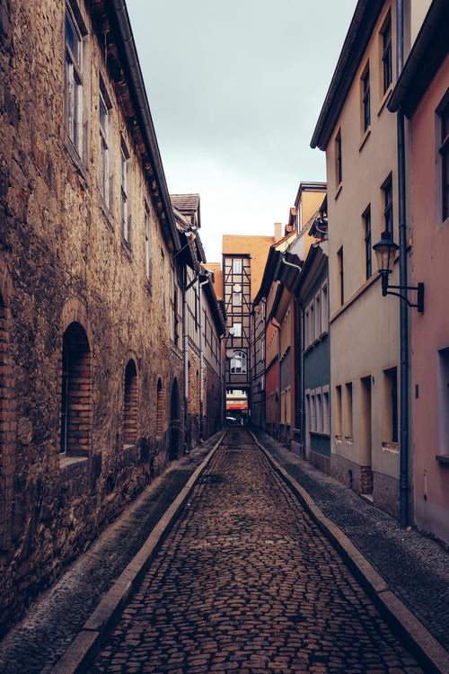 Architecture Building Building Exterior Built Structure City Cloud Day Diminishing Perspective Empty Narrow Naumburg No People Old Buildings Outdoors Residential Building Residential District Residential Structure Road Sky Stones The Way Forward Town Vanishing Point Walkway