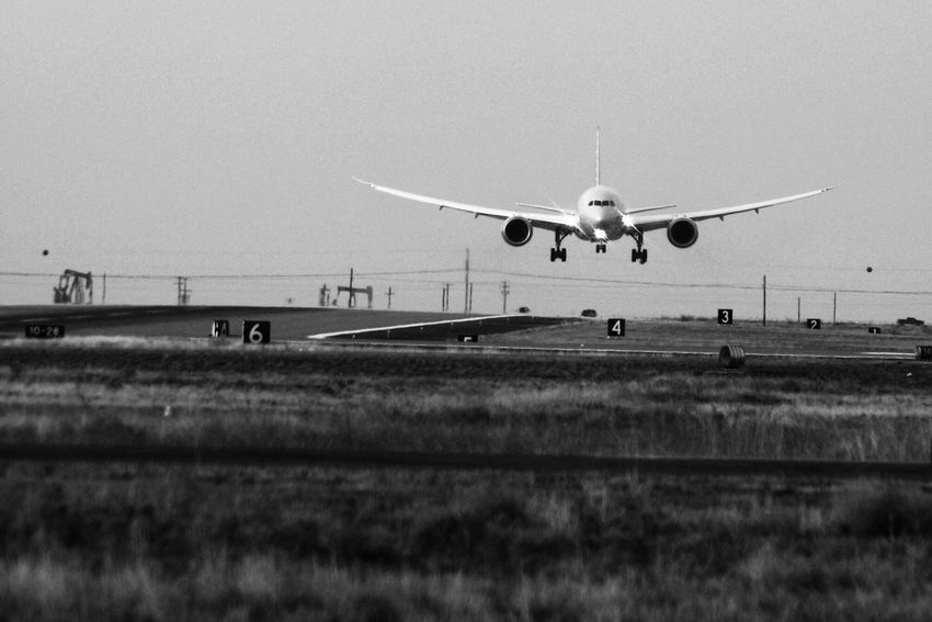 Airplane Transportation Flying Mode Of Transport Travel Air Vehicle Landing - Touching Down Journey Airport Mid-air No People Public Transportation Day Airport Runway Sky Runway Outdoors Nature 787 Dreamliner Aerospace Industry Commercial Airplane Monochrome Photography Oilfield Petroleum Industry