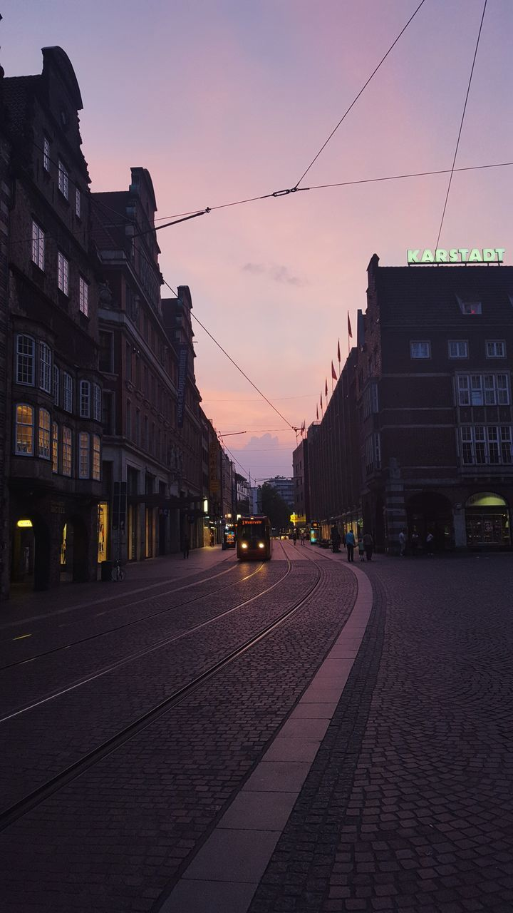 architecture, building exterior, built structure, sunset, street, cable, sky, outdoors, transportation, city, no people, nature, day