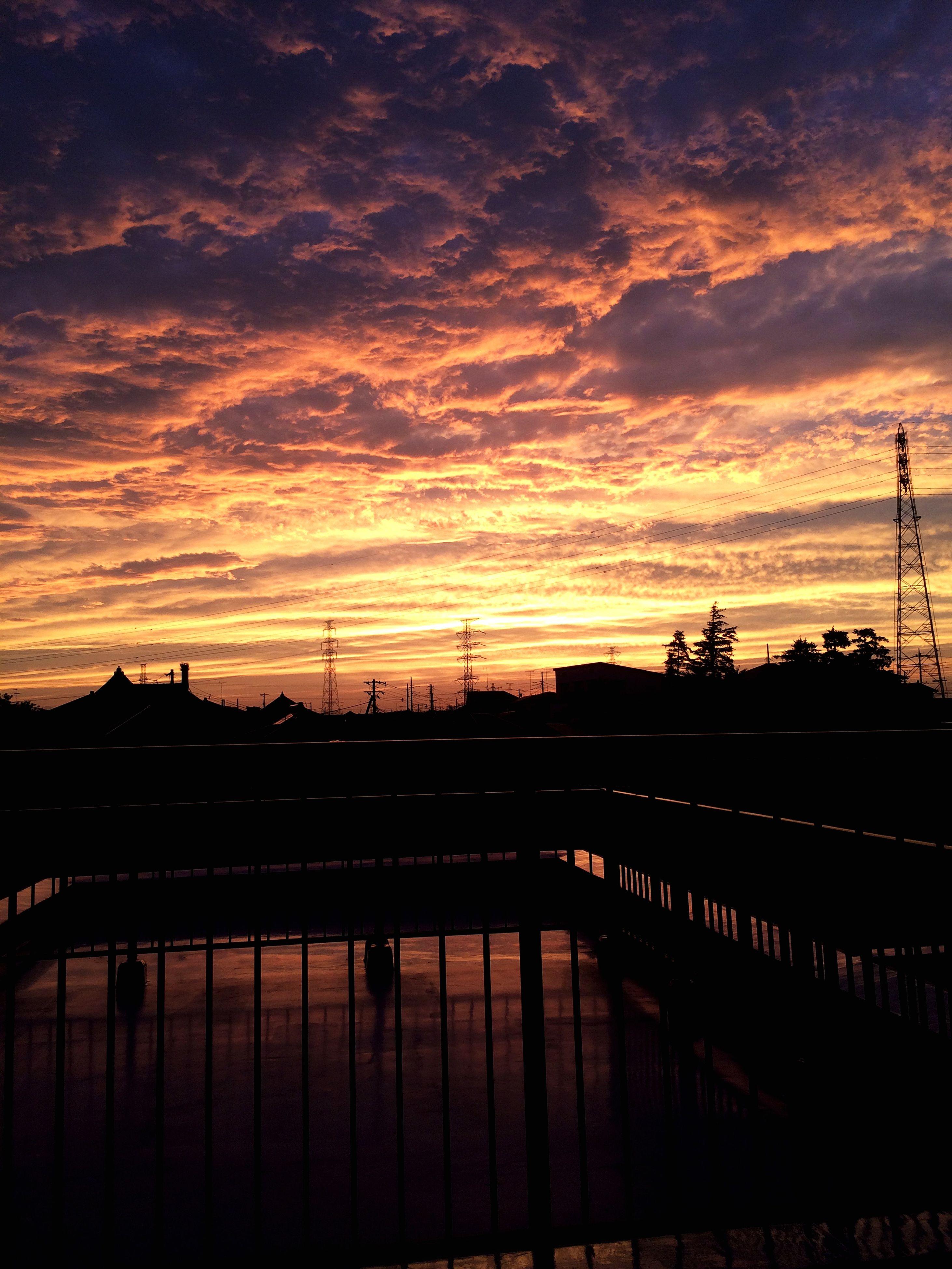 sunset, silhouette, sky, cloud - sky, connection, orange color, power line, built structure, electricity pylon, cloudy, cloud, bridge - man made structure, architecture, dusk, cable, transportation, dramatic sky, nature, railing, river