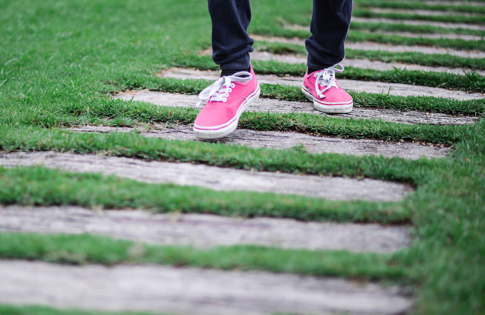 Athlete Close-up Grass Healthy Lifestyle Human Leg Low Section Men Millennial Pink Paths Pink Color Sports Clothing Sports Training Sportsman Standing Step By Step Track And Field Athlete
