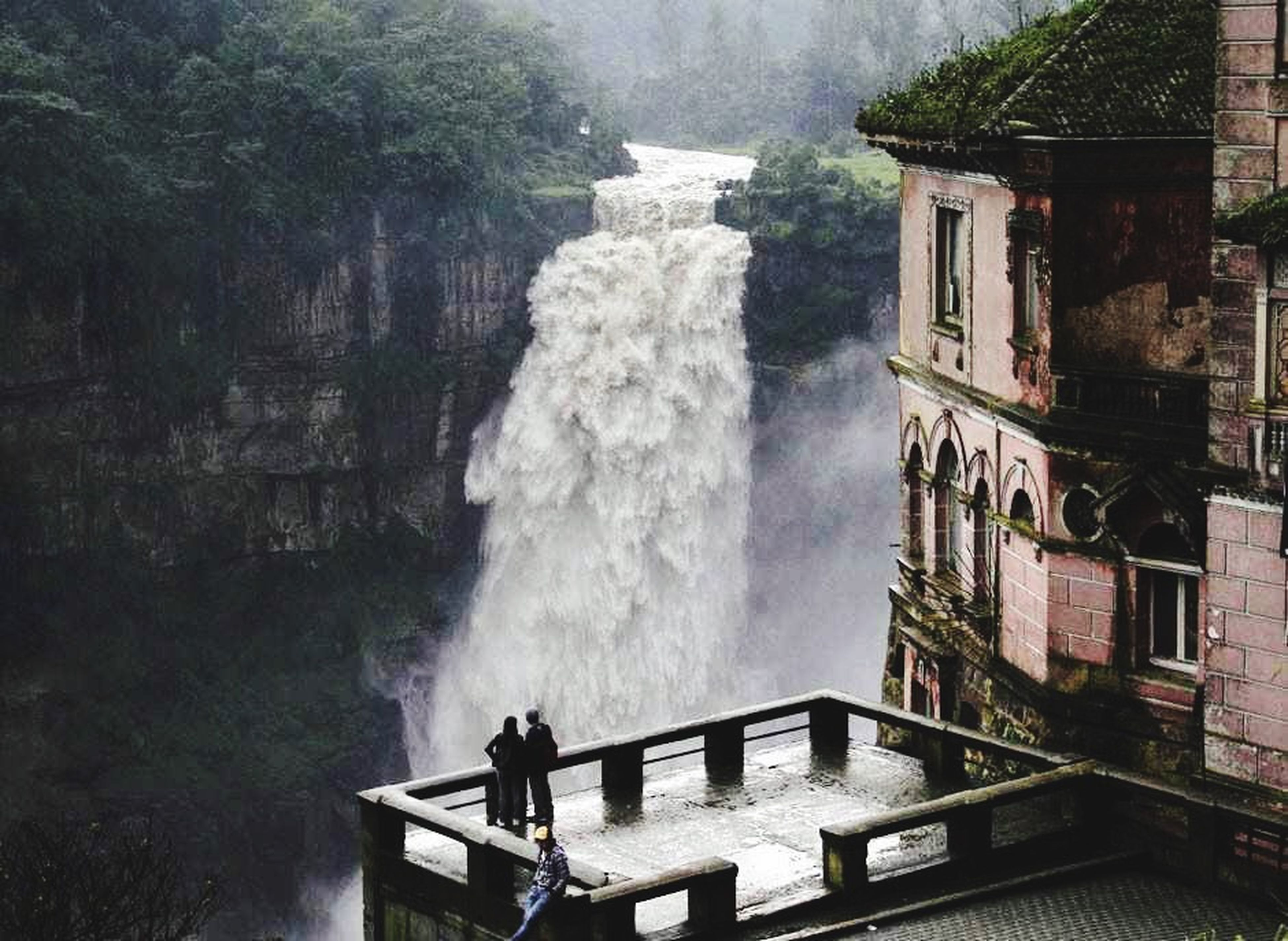 water, built structure, building exterior, architecture, men, lifestyles, leisure activity, person, waterfall, travel destinations, fountain, motion, day, tourism, flowing water, rear view, travel, famous place
