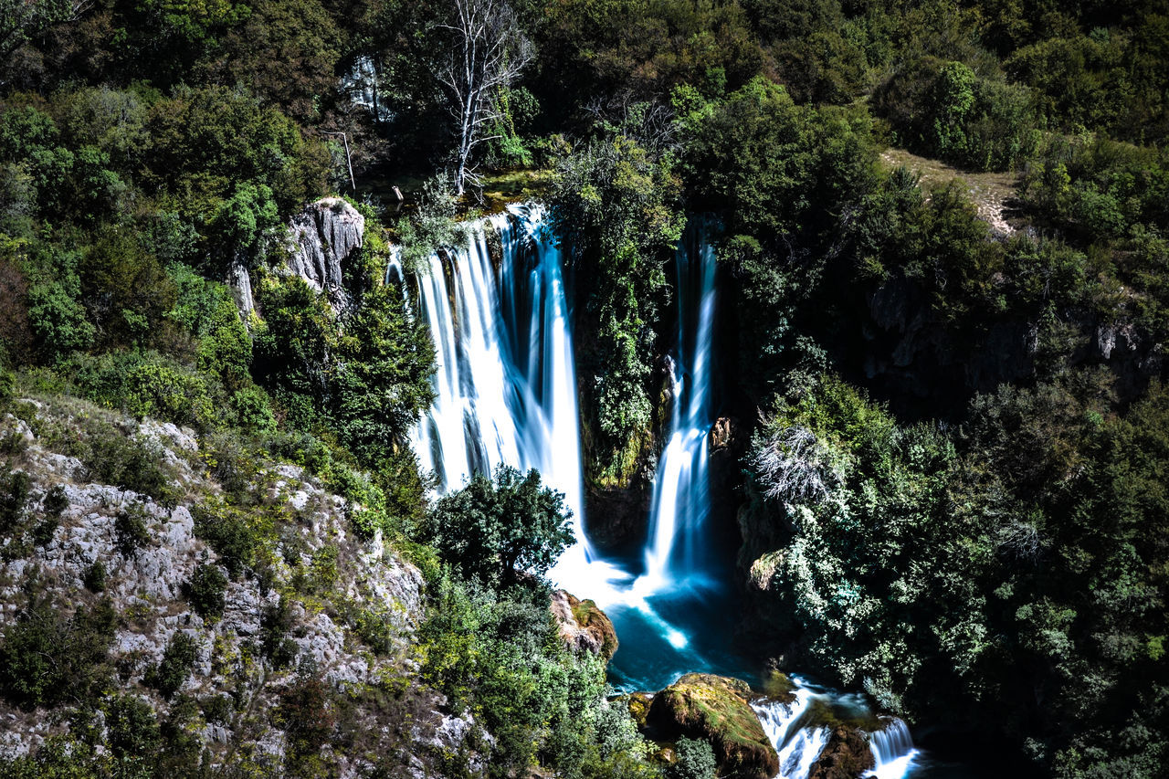First of 7 Krka waterfalls up in the croatian mountains Beauty In Nature Blue Branch Croatia Day Flowing Flowing Water Forest Growth Krka Krka National Park Motion Nature Non-urban Scene Purity Rock Rock Formation Scenics Tranquil Scene Tranquility Tree Water Waterfall Waterfalls White