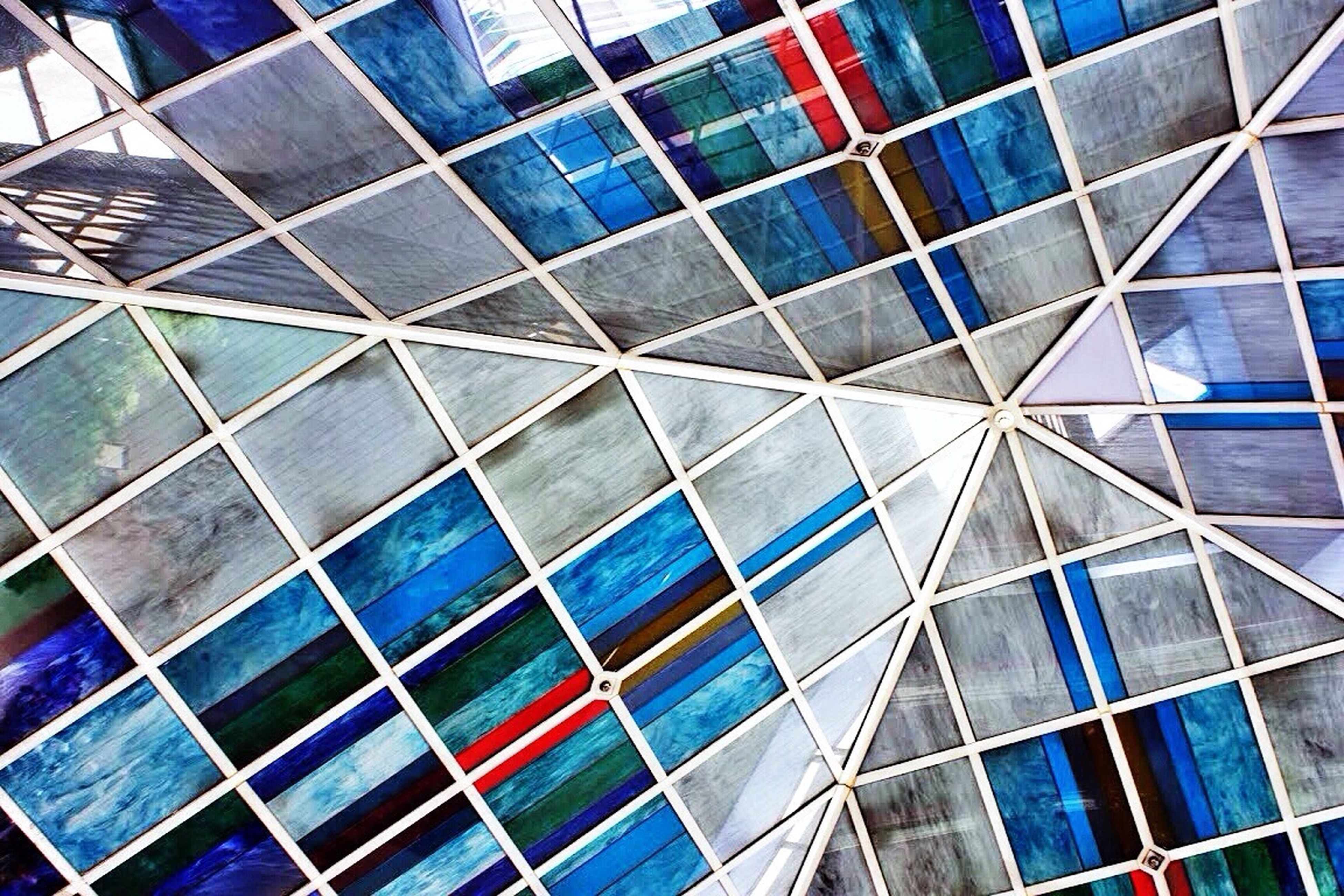 modern, full frame, architecture, backgrounds, building exterior, built structure, pattern, office building, city, skyscraper, glass - material, reflection, low angle view, building, multi colored, blue, tall - high, design, geometric shape, repetition