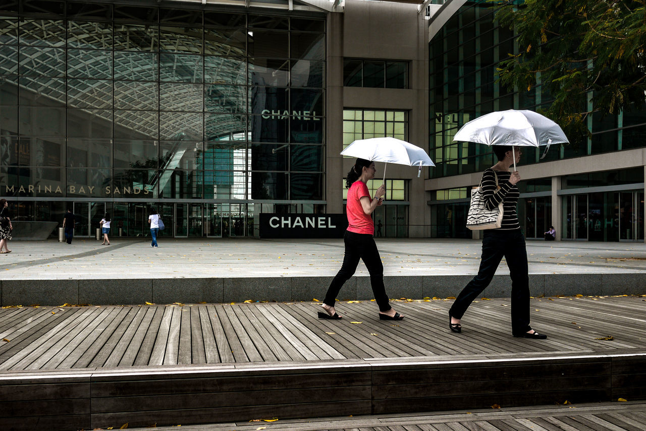 Lifestyles Protection Adult Outdoors People Built Structure Architecture City Day Umbrella Walking Friends Women Shopping Mall Marina Bay Sands Singapore Street Photography Streetphotography Streetphoto_color Streetlife Street Life Everybodystreet Panasonic GF1