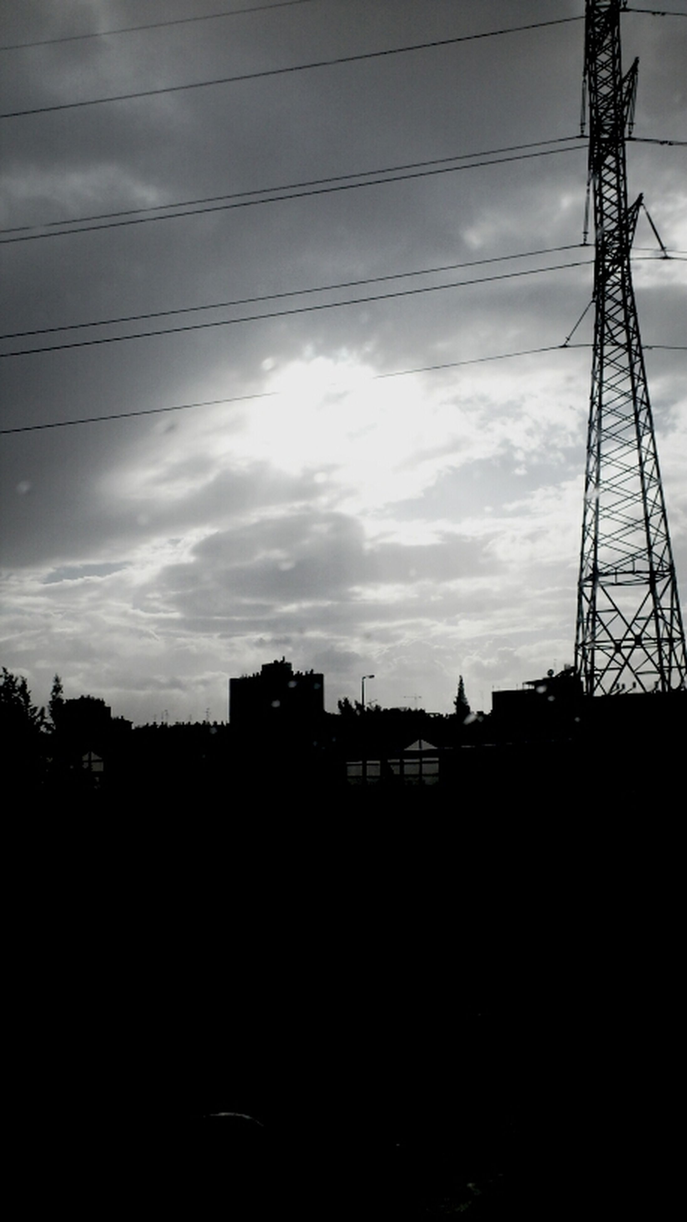 silhouette, power line, built structure, architecture, electricity pylon, building exterior, sky, sunset, electricity, low angle view, power supply, connection, cable, cloud - sky, fuel and power generation, dusk, city, technology, cloud, crane - construction machinery