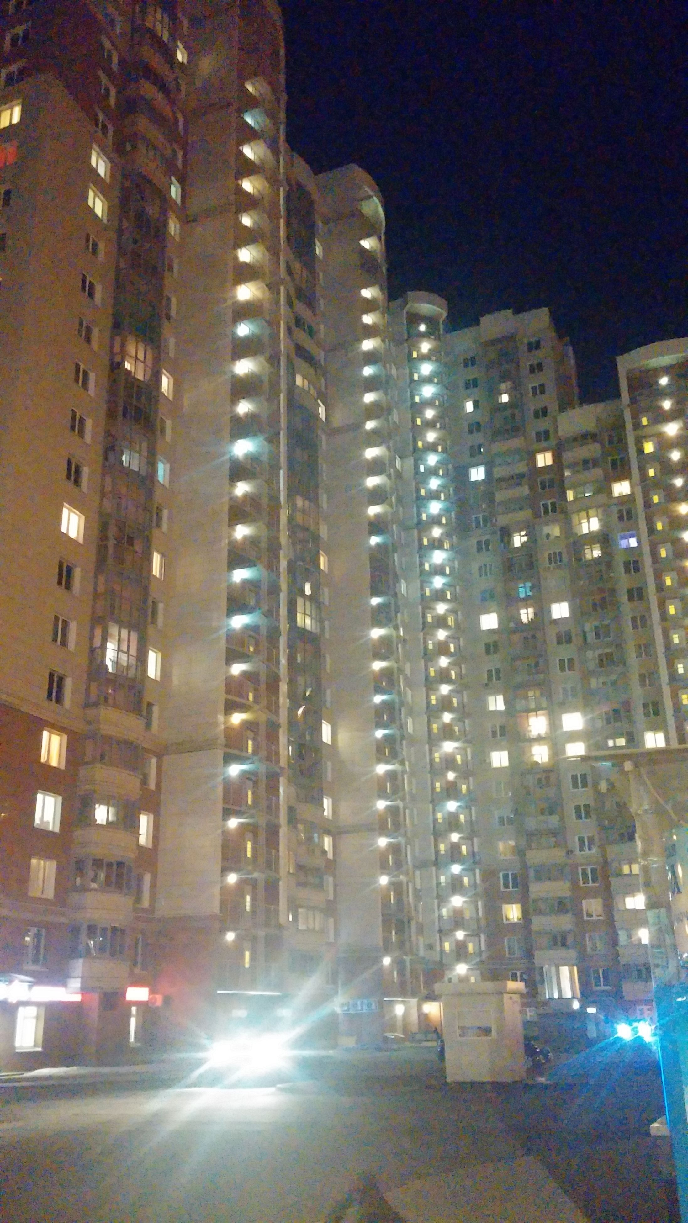 building exterior, architecture, illuminated, night, built structure, city, low angle view, tall - high, building, skyscraper, tower, travel destinations, capital cities, city life, famous place, light - natural phenomenon, outdoors, travel, office building, street