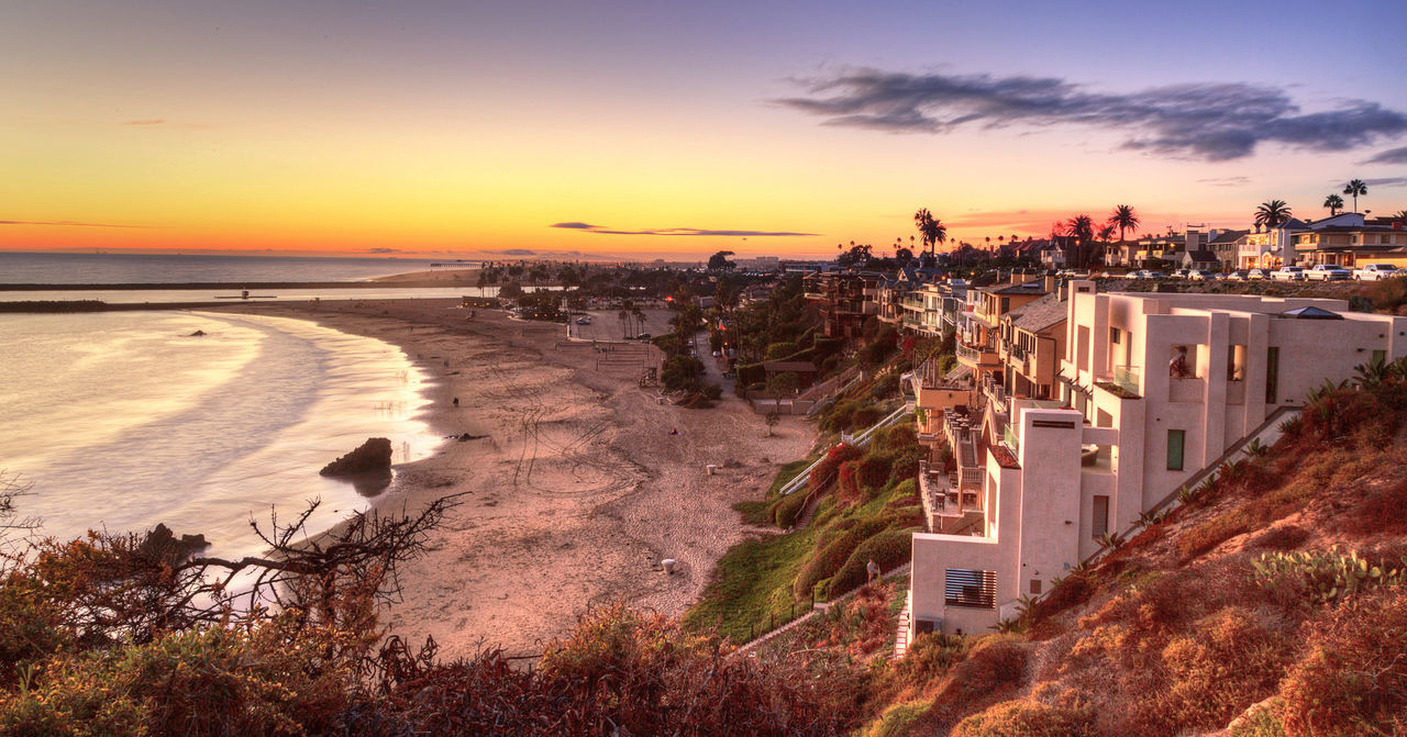 Corona Del Mar Beach in Corona Del Mar, California at sunset in summer Architecture Beach Building Exterior California City Cityscape Cliffs Corona Del Mar Corona Del Mar Beach Day Newport Beach, CA, USA No People Orange County Outdoors Panoramic Sea Summer Sunset Sunsets Tourism Travel Destinations United States Urban Skyline