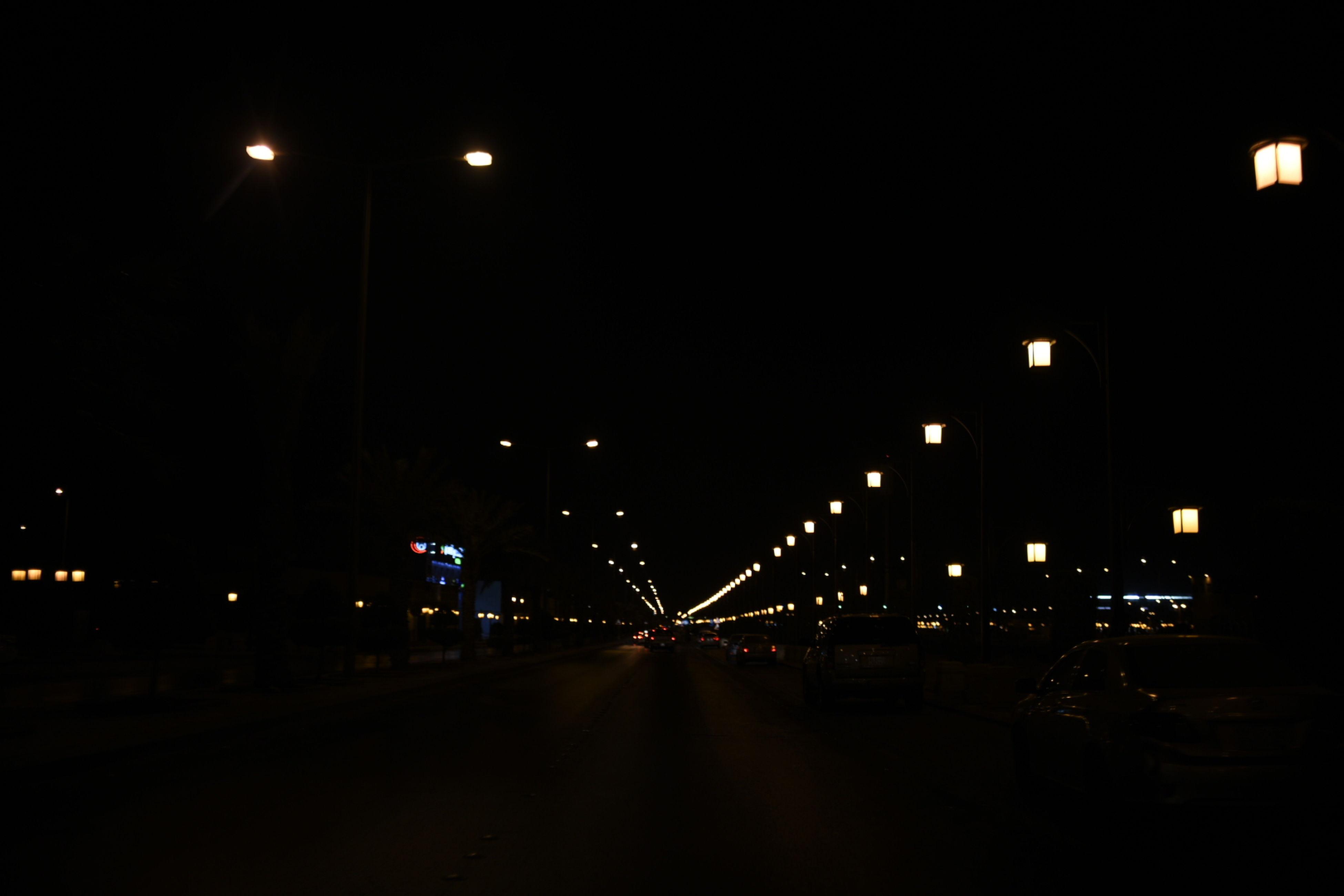 illuminated, night, transportation, road, the way forward, diminishing perspective, dark, vanishing point, sky, long, city life, lit, tail light, journey, darkness