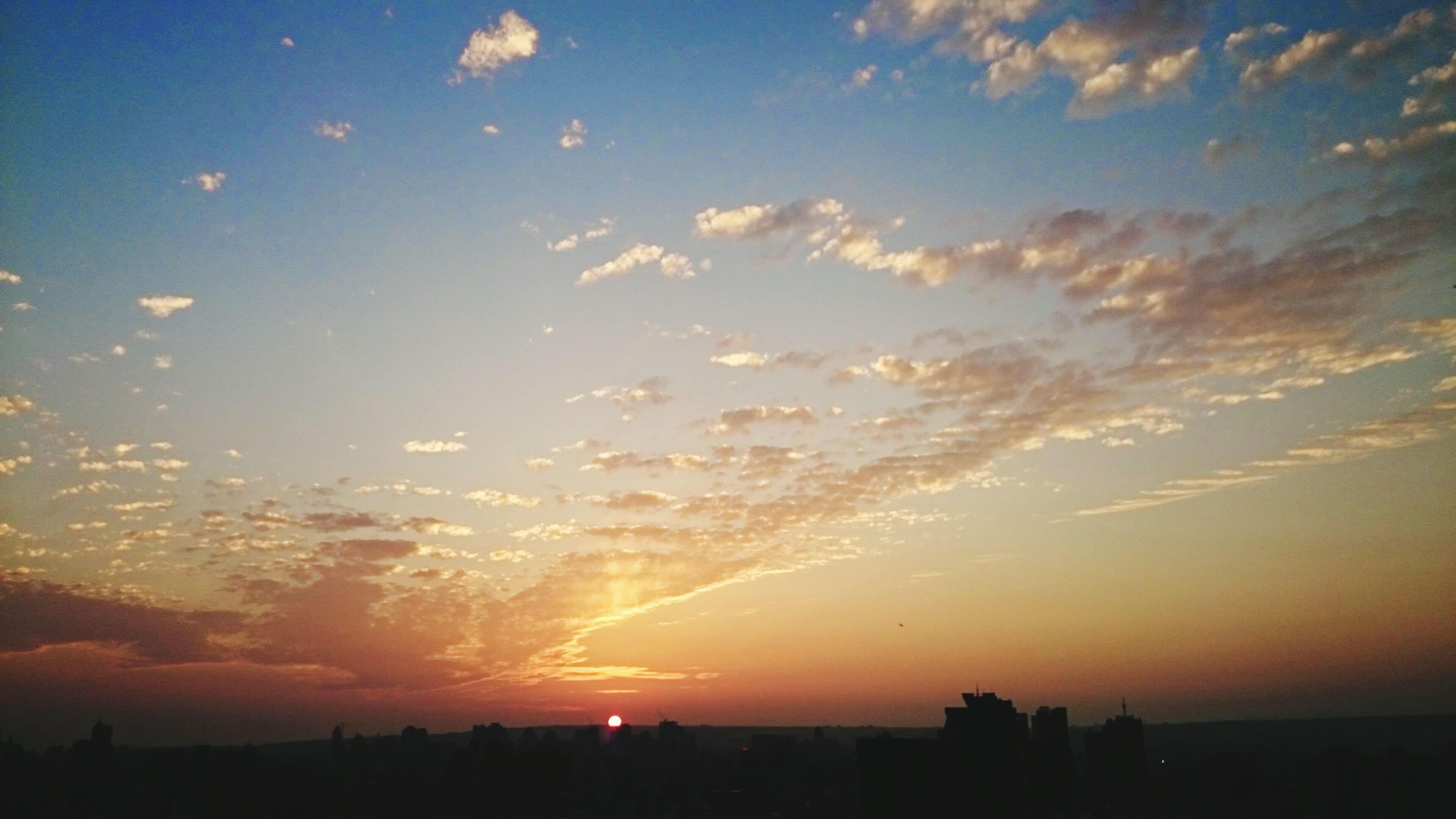 sunset, silhouette, scenics, sky, cityscape, beauty in nature, city, building exterior, tranquil scene, landscape, nature, orange color, tranquility, cloud - sky, idyllic, built structure, sun, architecture, outdoors, no people
