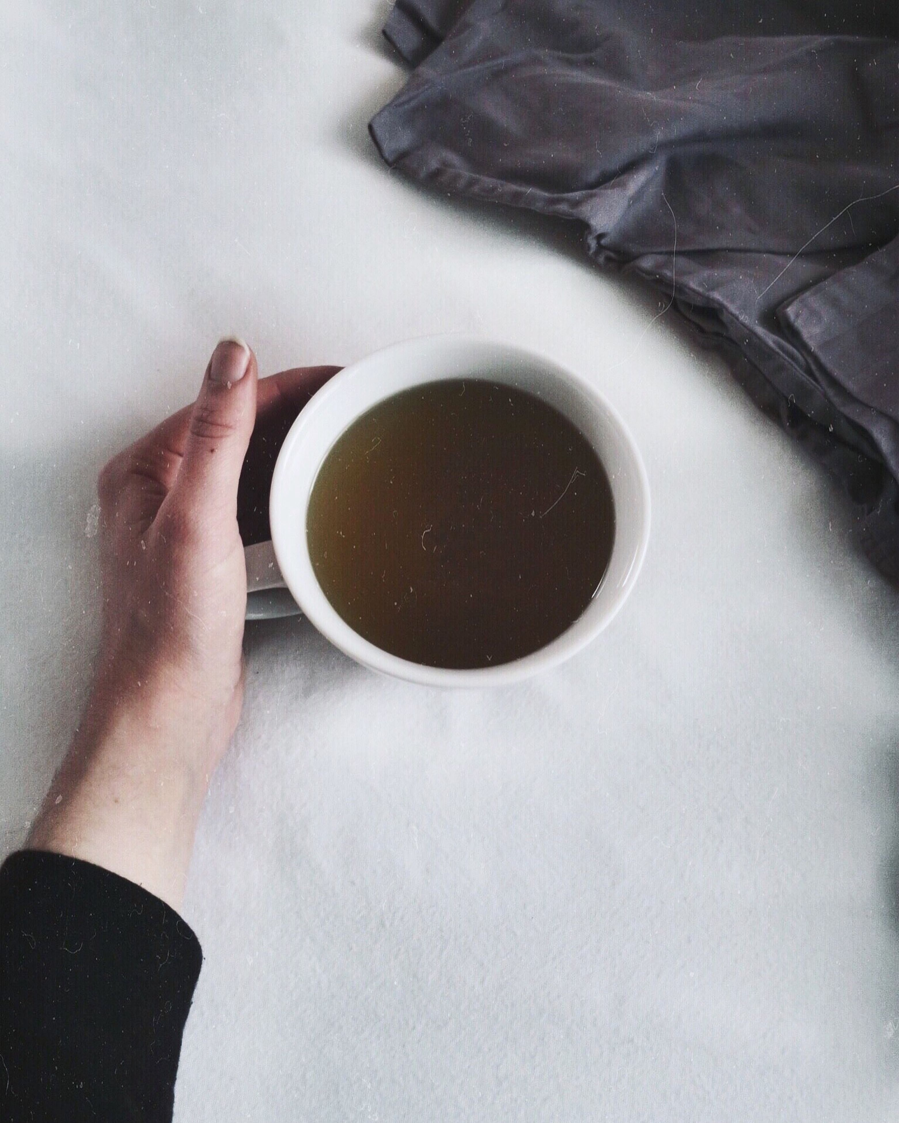 food and drink, human hand, human body part, one person, refreshment, drink, tea cup, real people, tea - hot drink, indoors, freshness, one woman only, table, close-up, people, adults only, day, adult