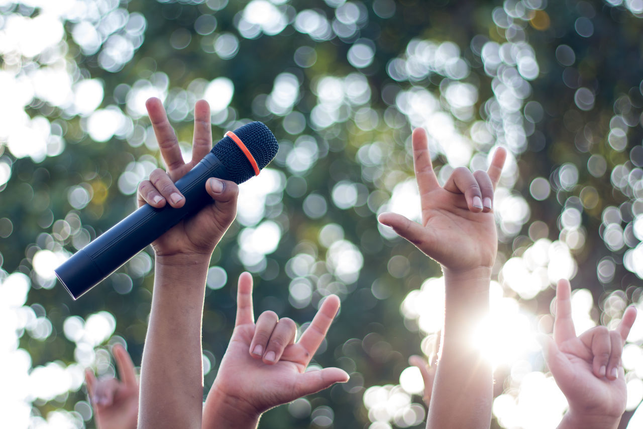 Beautiful stock photos of handy,  Arms Raised,  Audio Equipment,  Communication,  Day