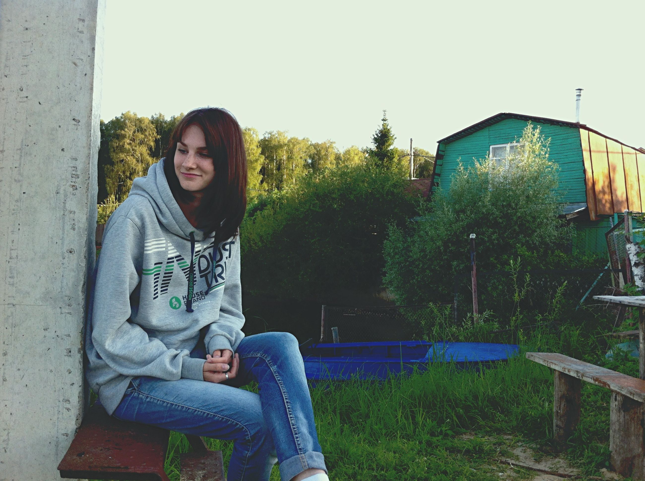 person, casual clothing, lifestyles, leisure activity, sitting, portrait, grass, tree, relaxation, day, plant, green color, front or back yard, outdoors