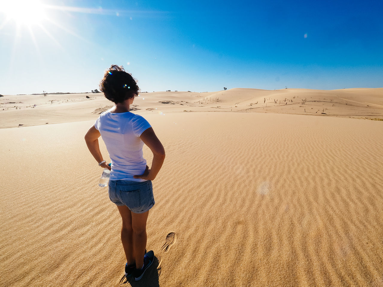 Arid Climate Beach Beauty In Nature Childhood Clear Sky Day Desert Epic Isolated Lonely Nature One Person Outdoors People Real People Rear View Sand Sand Dune Scenics Sky Sun Sunlight Vast