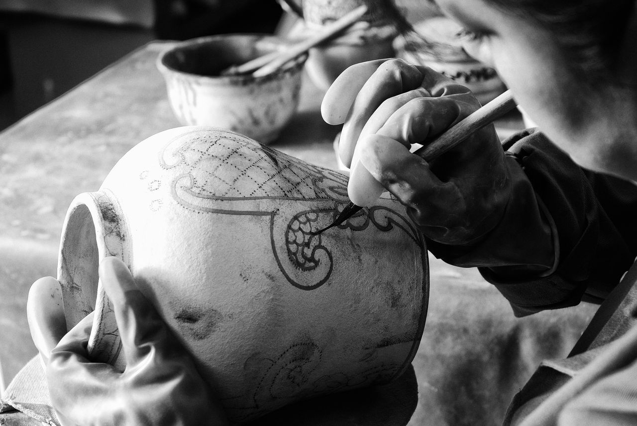 Talavera pottery being painted Art And Craft Artist Clay Close-up Creativity Holding Human Hand Indoors  Mexican Handcraft Occupation One Person People Popular Art Pottery Real People Skill  Working
