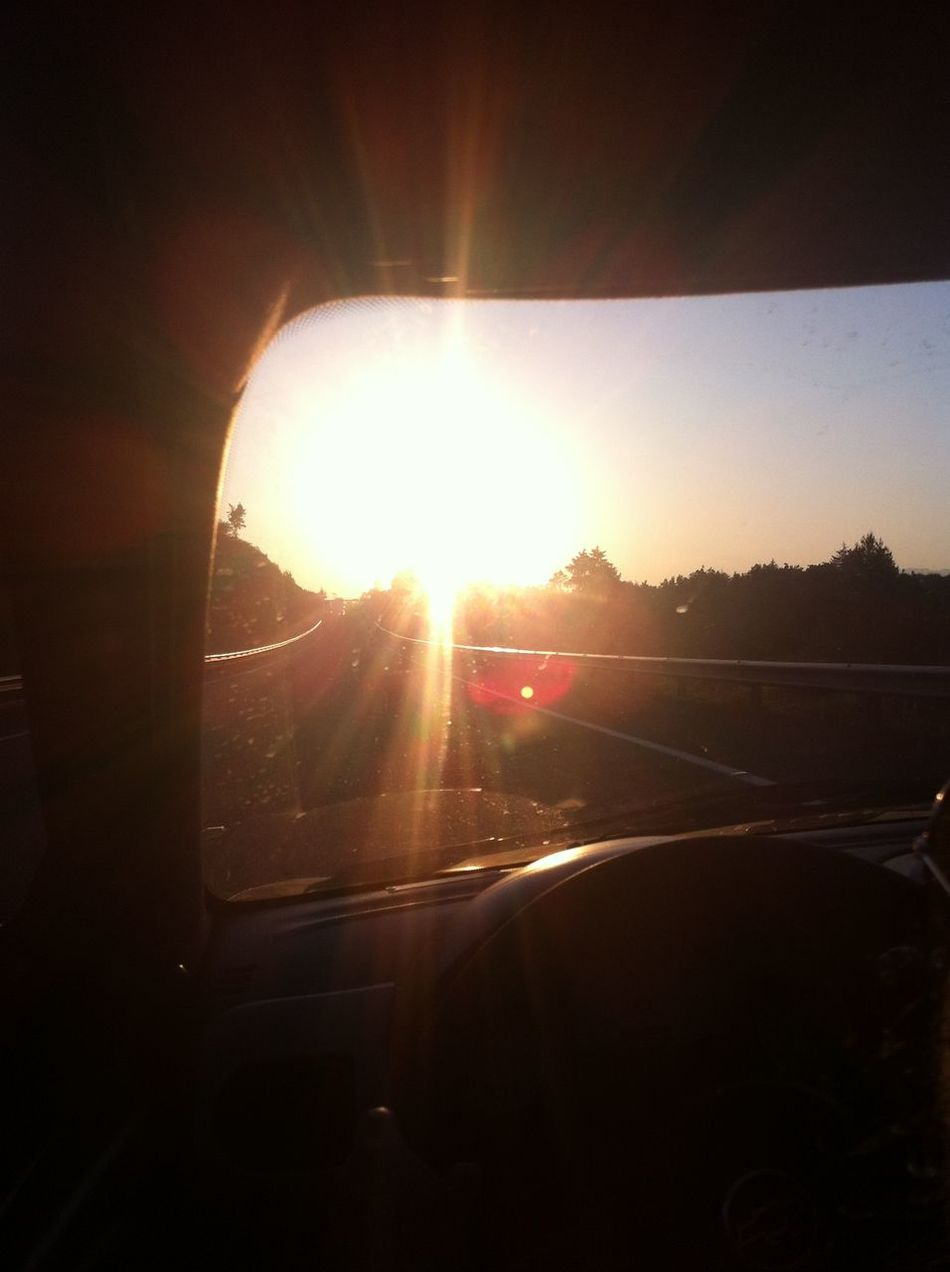 Beauty In Nature Car Car Interior Close-up Day Land Vehicle Landscape Lens Flare Mode Of Transport Nature No People Outdoors Sky Steering Wheel Sun Sunbeam Sunlight Sunset Transportation Vehicle Interior Vehicle Mirror Windscreen
