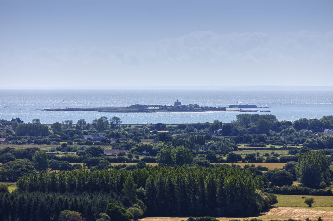 Panoramic View of Peninsula Cotentin in Basse Normandy, France - In the distance the island Tatihou near Saint-Vaast-la-Hougue, Basse Normandy, France Aerial View Agriculture Atlantic Ocean Building Exterior Cotentin Countryside Farm Farmhouse France Horizon Over Water Idyllic Island Landscape Landscape_Collection Landscape_photography Nature Normandy Panorama Patchwork Landscape Rural Scene Saint-vaast-la-hougue Scenics Sea Tatihou Village